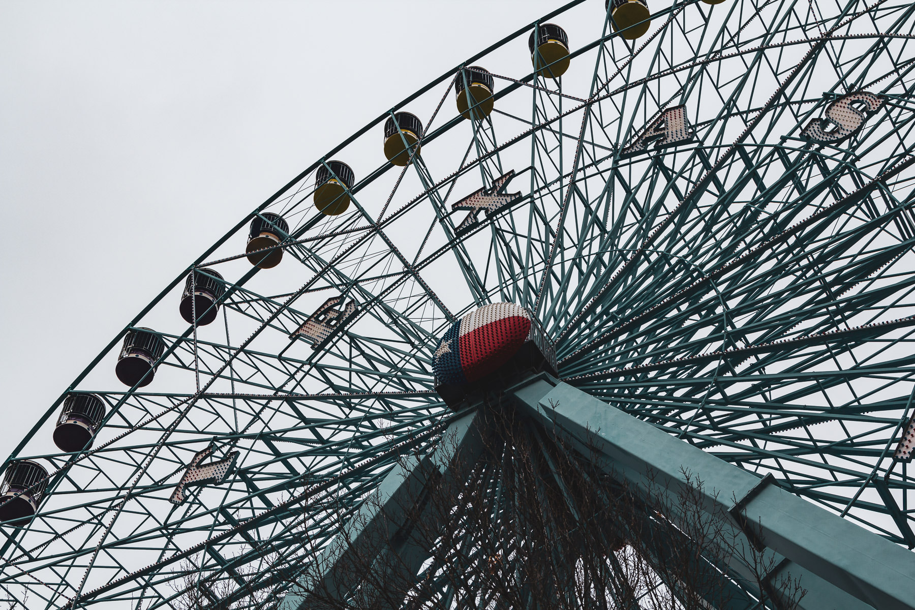 The Texas Star Ferris wheel rises into the overcast sky over Dallas' Fair Park.