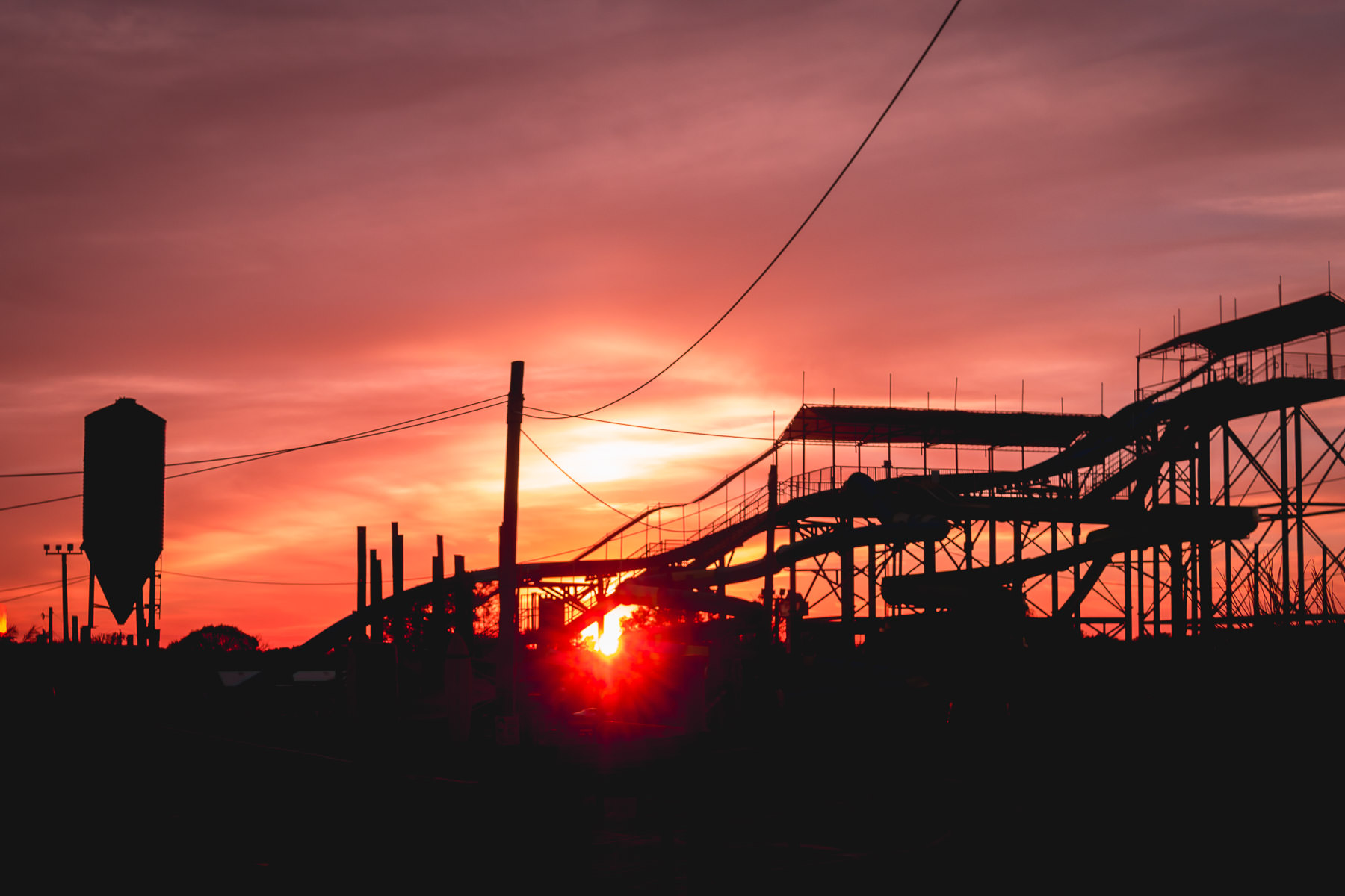 The sun sets on water slides at Pirates' Cove water park in Burleson, Texas.