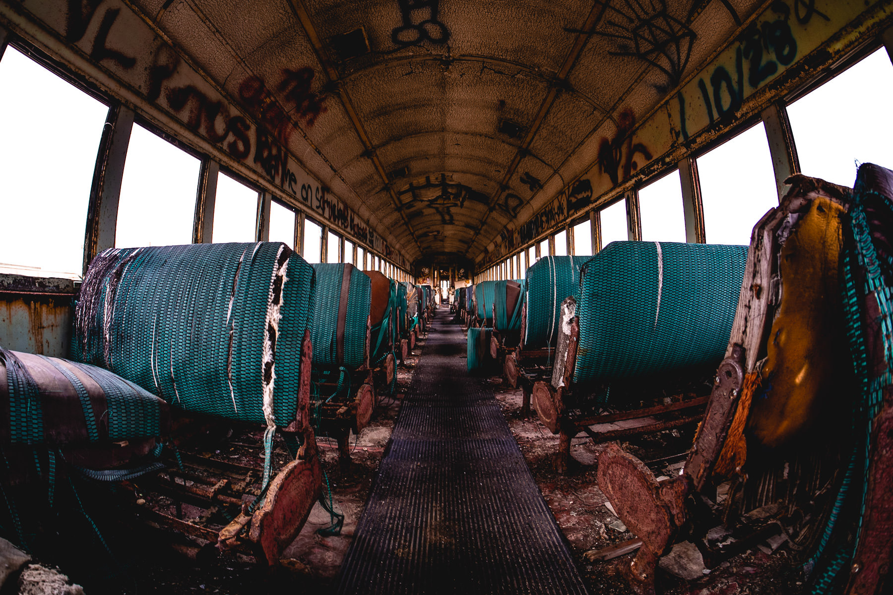 The interior of an abandoned railcar rotting in the Union Pacific rail yard at Galveston, Texas.