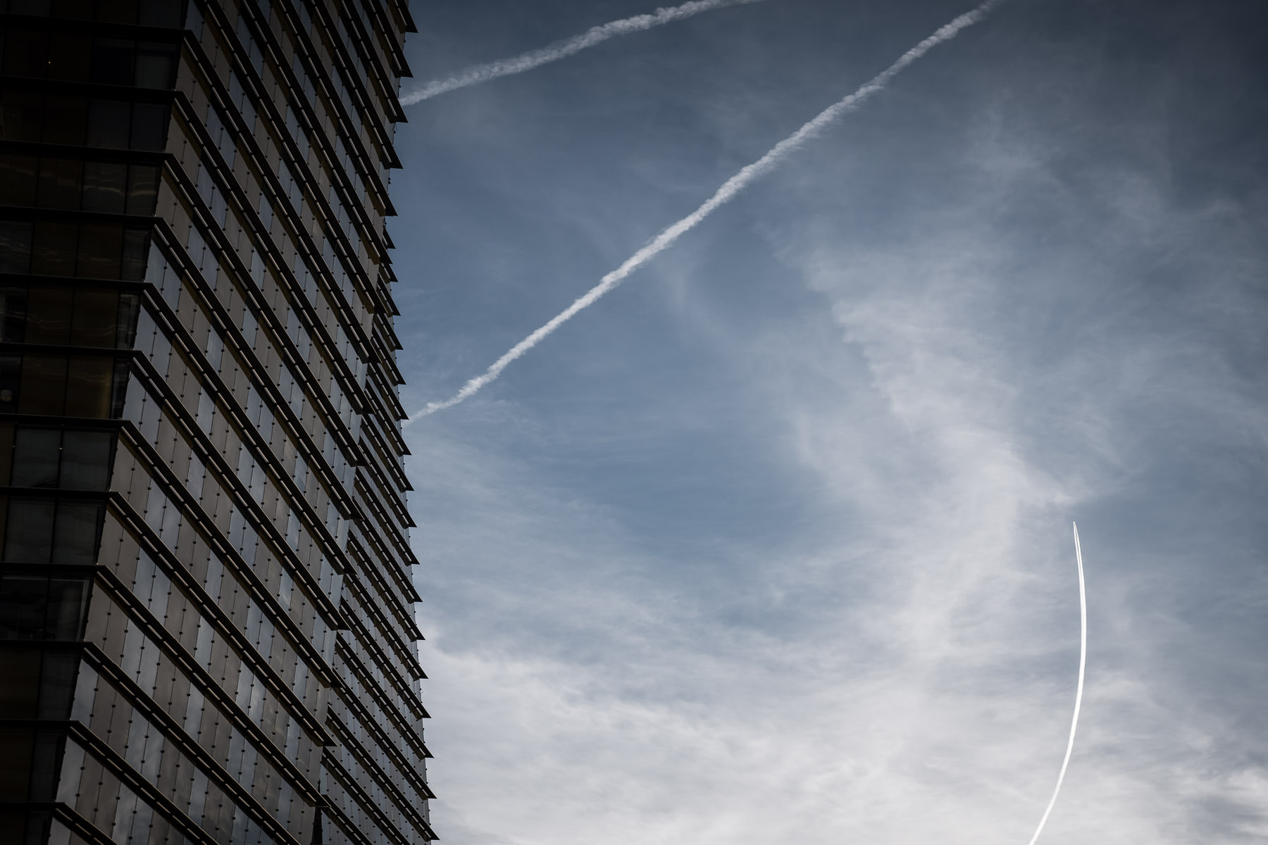 Jet contrails slice through the sky above Las Vegas' Veer Towers.