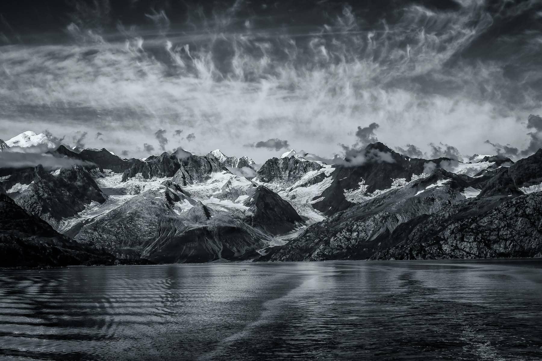 Mountains dramatically rise along the coastline of Alaska's Glacier Bay.