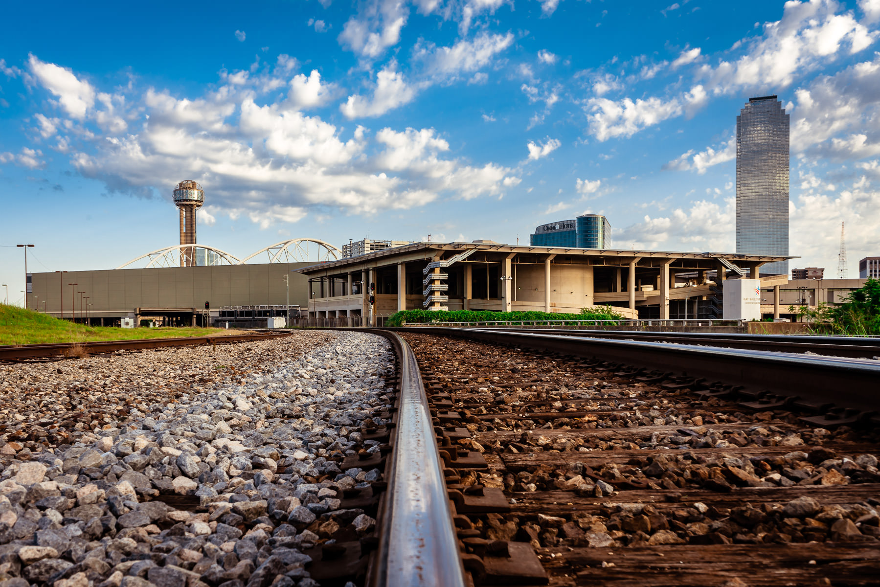 A railroad line leads towards the Dallas Convention Center and its adjacent heliport.