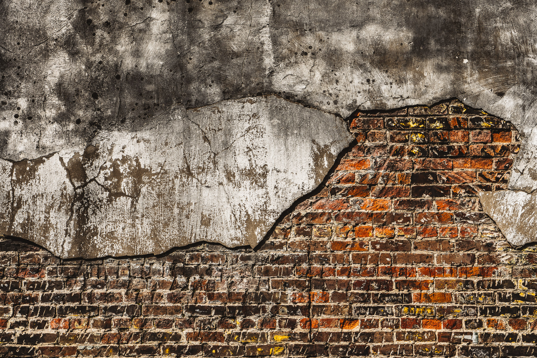 A brick wall crumbles in Downtown McKinney, Texas.