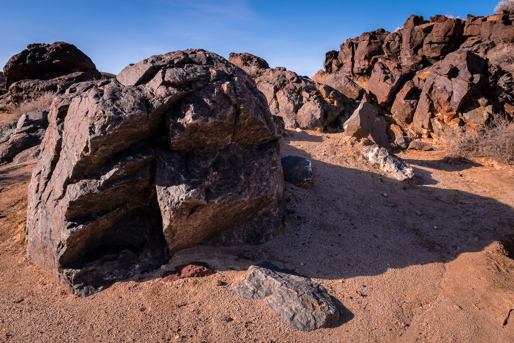 Ancient rocks cast late afternoon shadows in California's Mojave National Preserve.