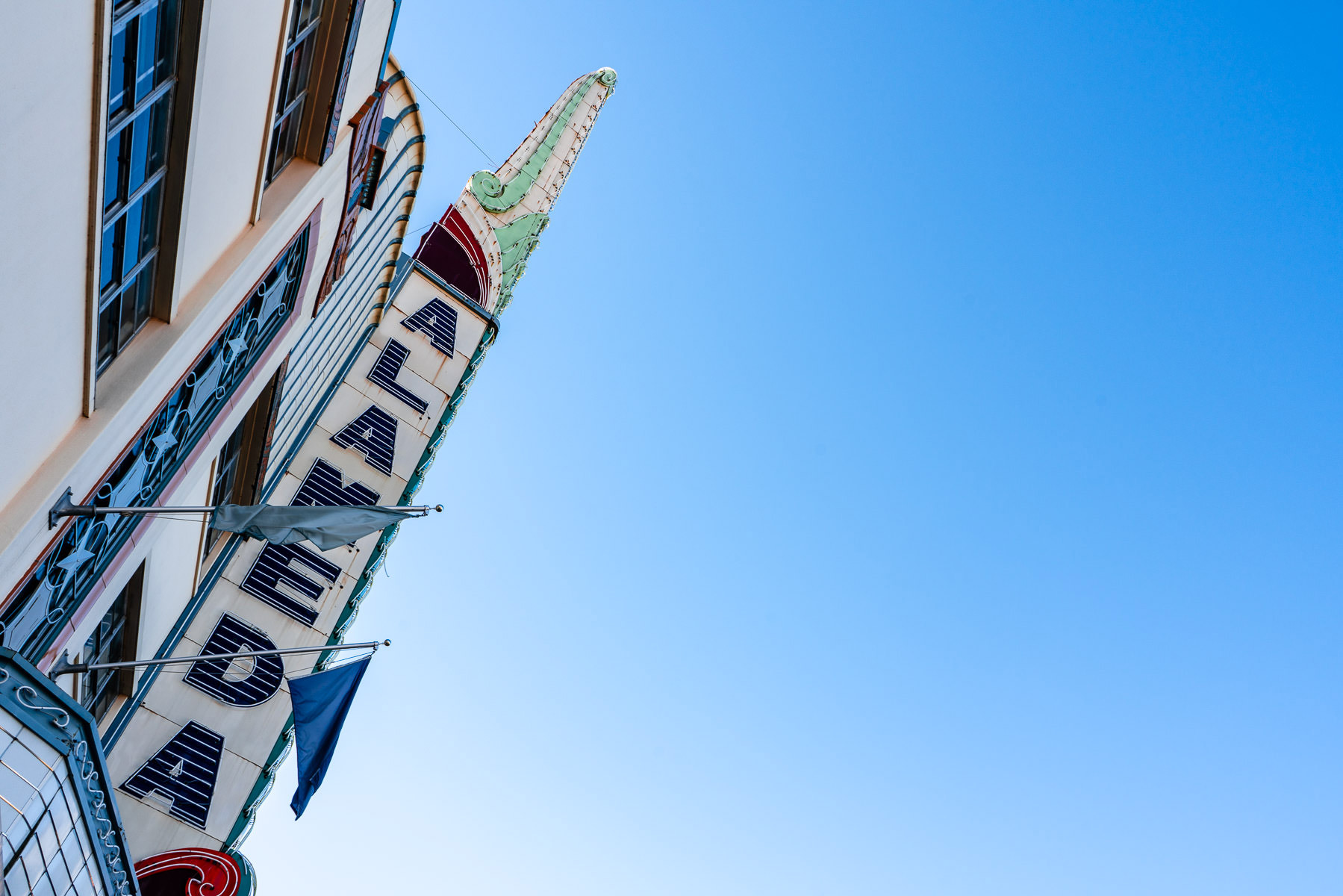 The sign of the historic Alameda Theater rises into the blue sky over Downtown San Antonio, Texas.