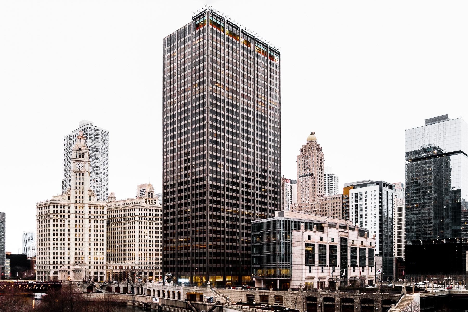 401 North Michigan—formerly known as the Equitable Building—rises along the Chicago River into the overcast Illinois sky.