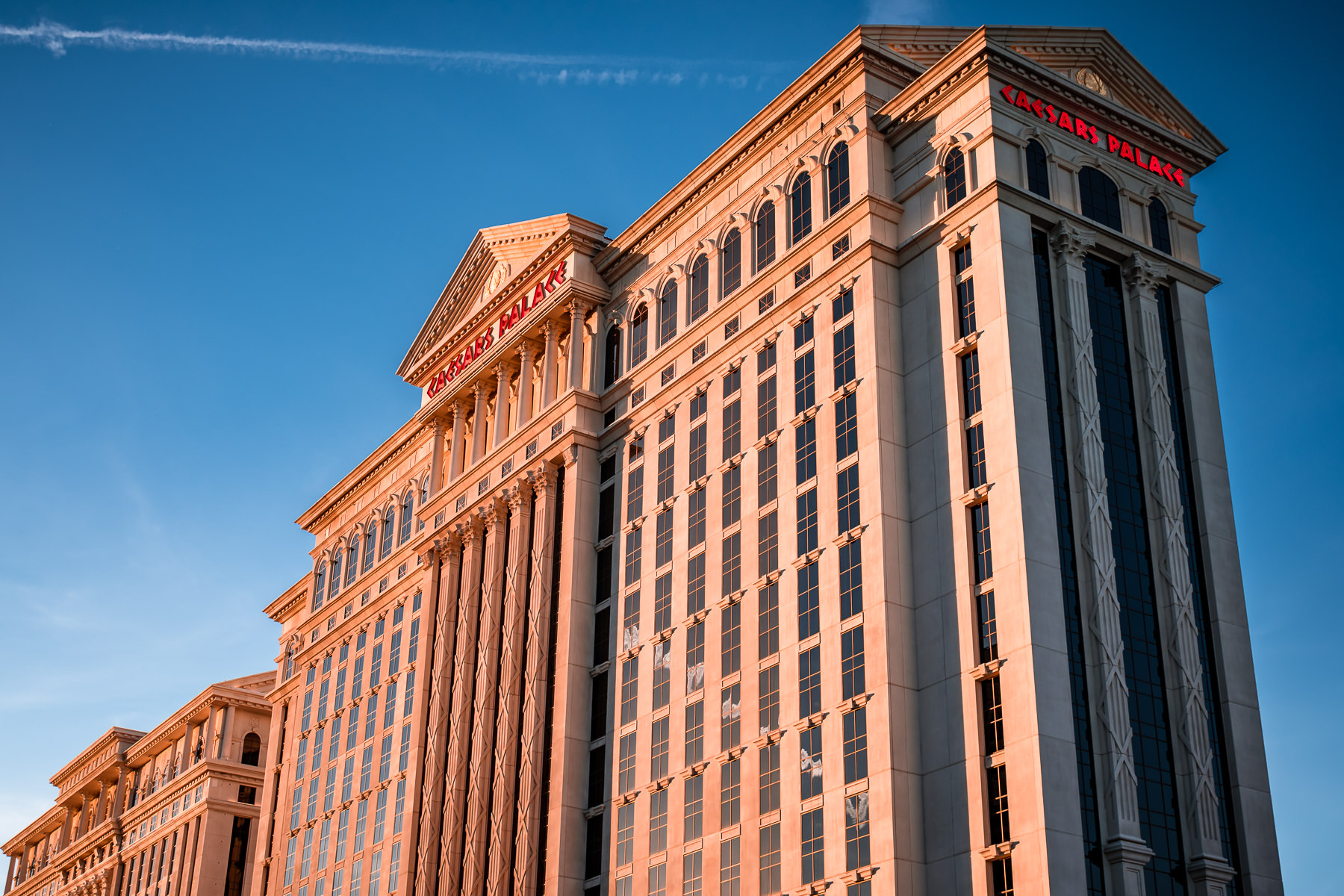 Caesars Palace's Augustus Tower rises into the early-evening Las Vegas sky.