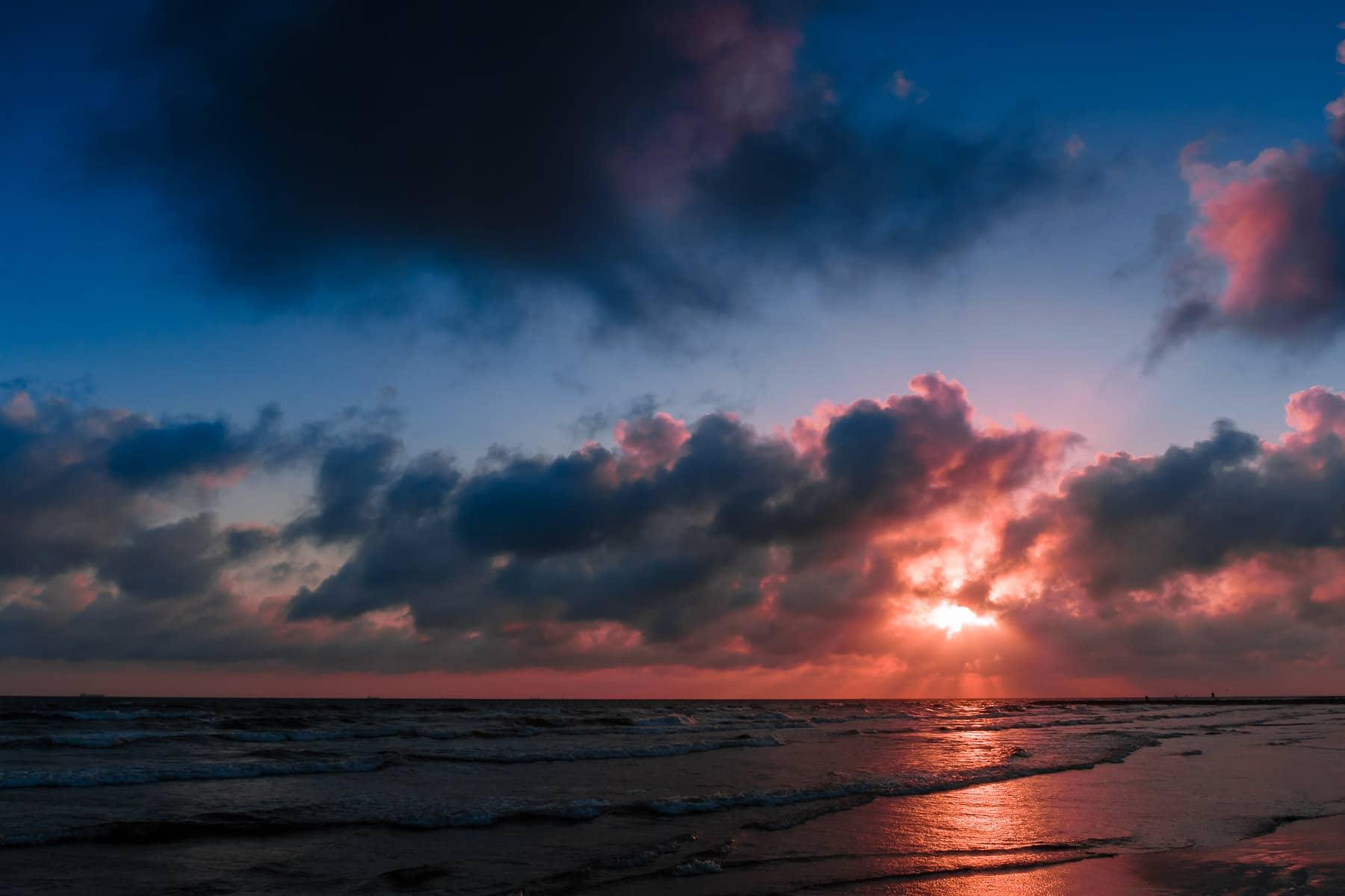 The sun rises on a Galveston, Texas, beach.