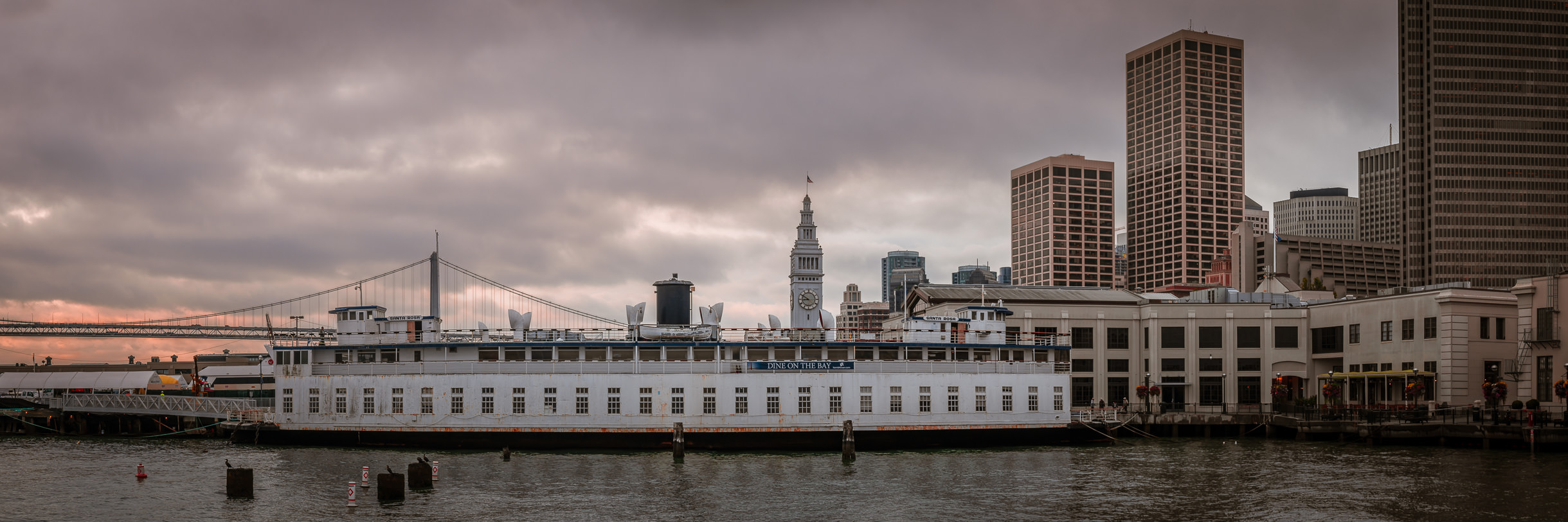 The sun rises on San Francisco's Financial District and the history 1927 ferrySanta Rosa, now permanently moored as an event center.
