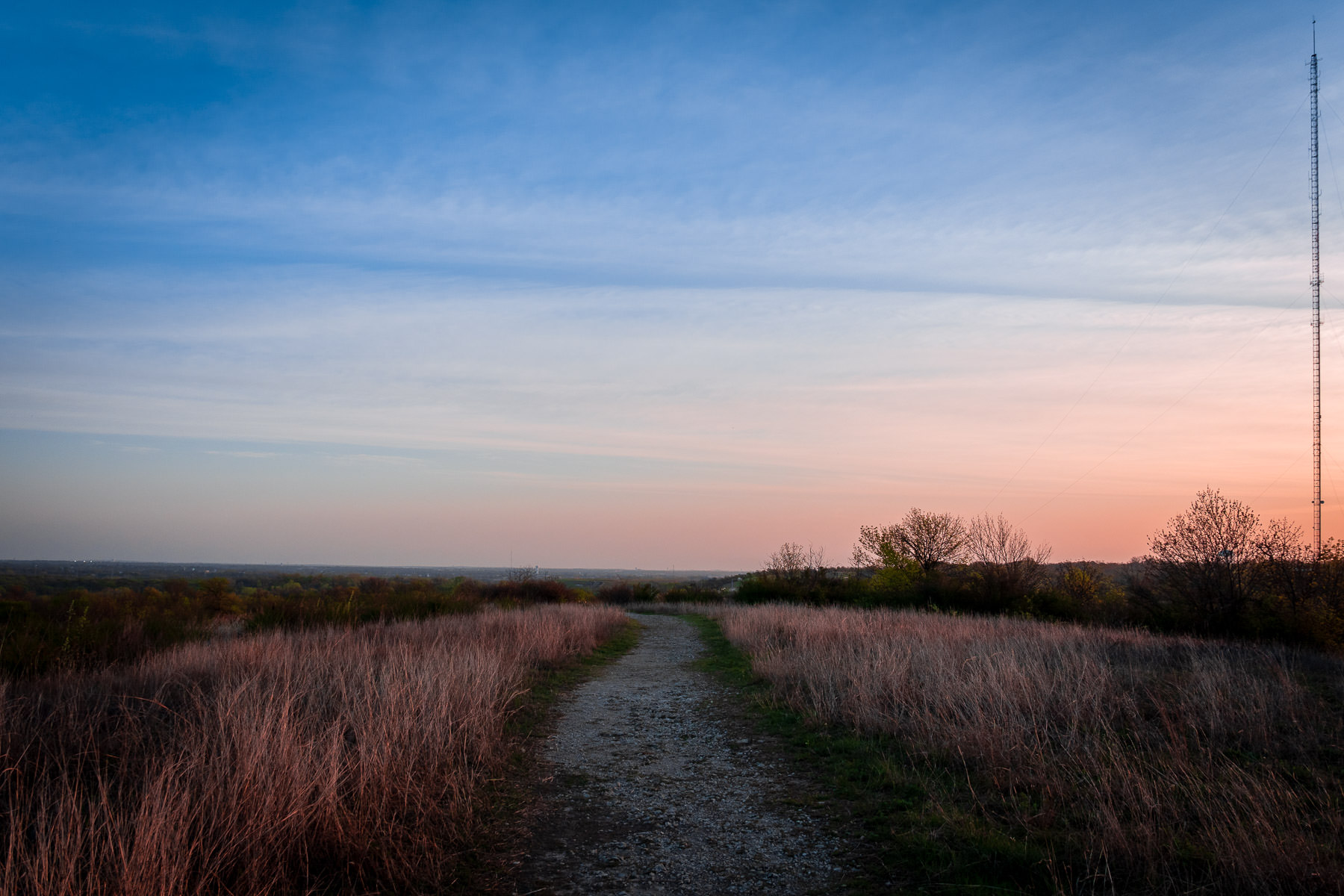 The sun rises over a hilltop path at Fort Worth, Texas' Tandy Hills Natural Area.