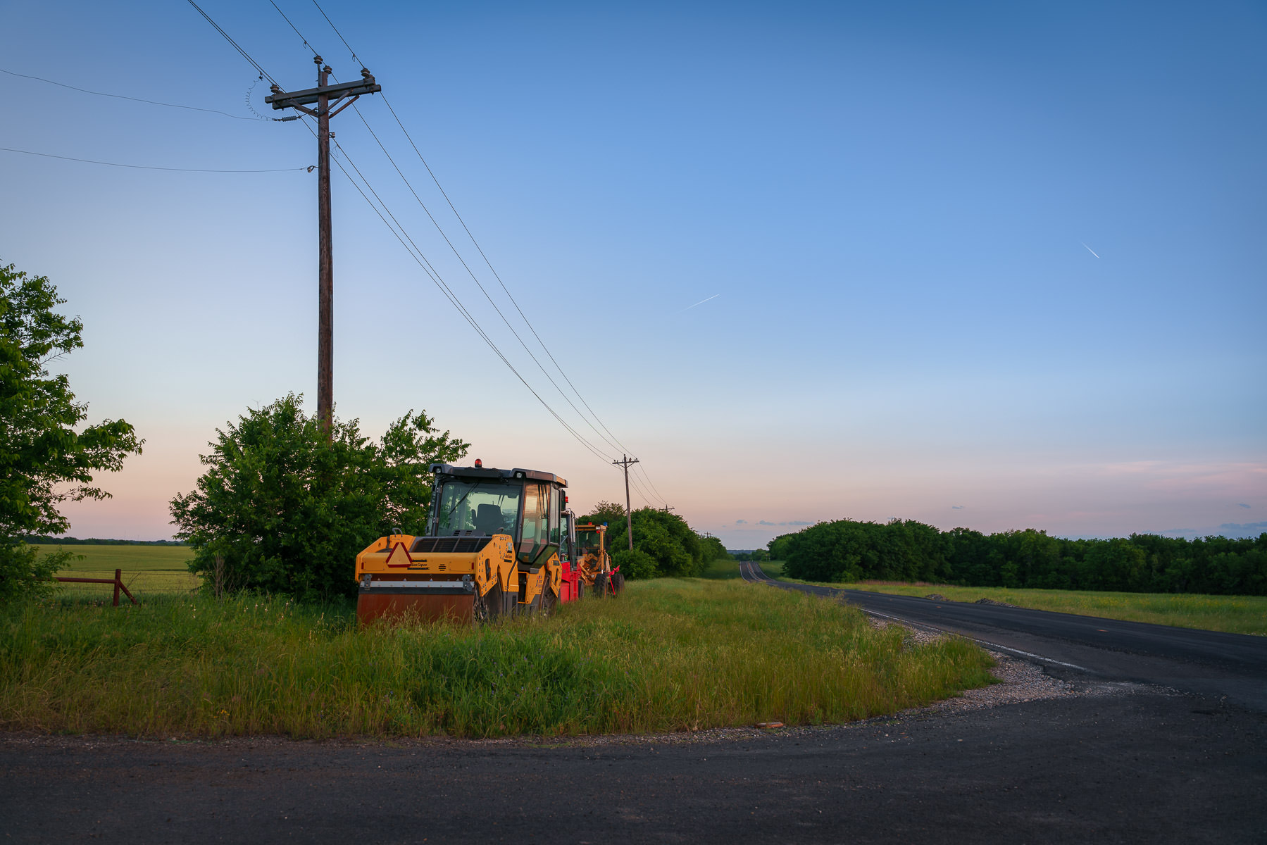 Construction equipment parked alongside a country road near Anna, Texas.
