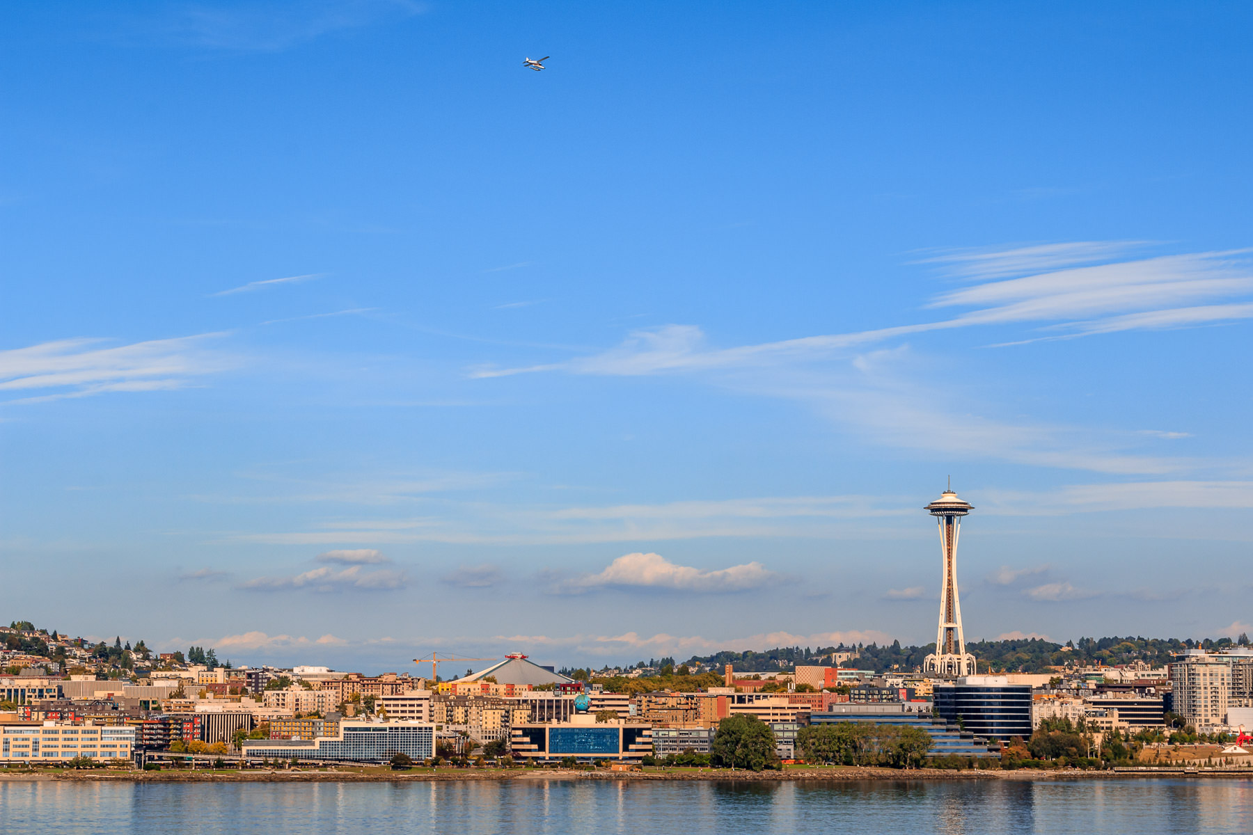 A seaplane flies over Seattle's Queen Anne neighborhood.