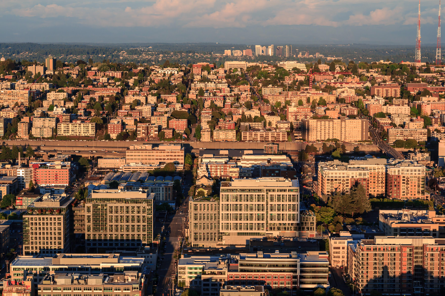 Seattle's Queen Anne neighborhood stretches into the distance as the sun sets on the city.