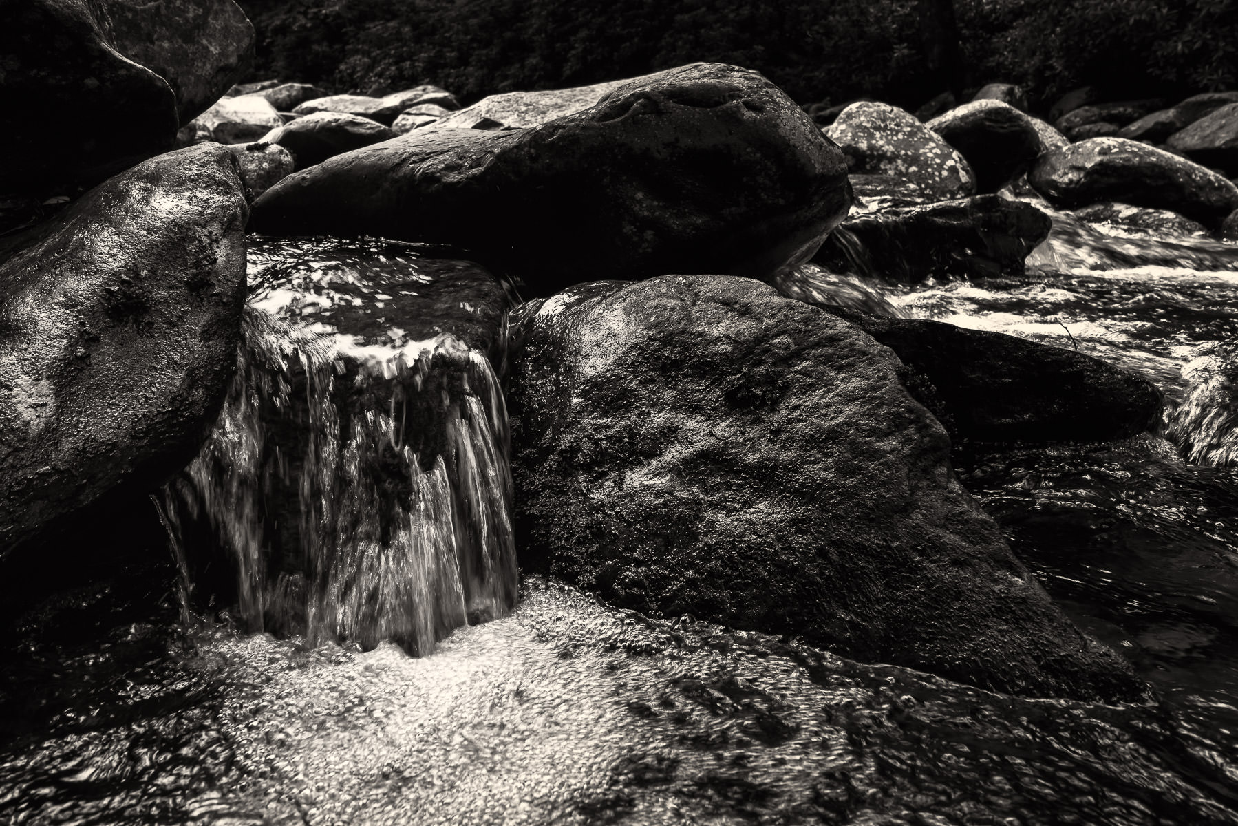 A stream's waters rush over rocks in the Great Smoky Mountains National Park, Tennessee.