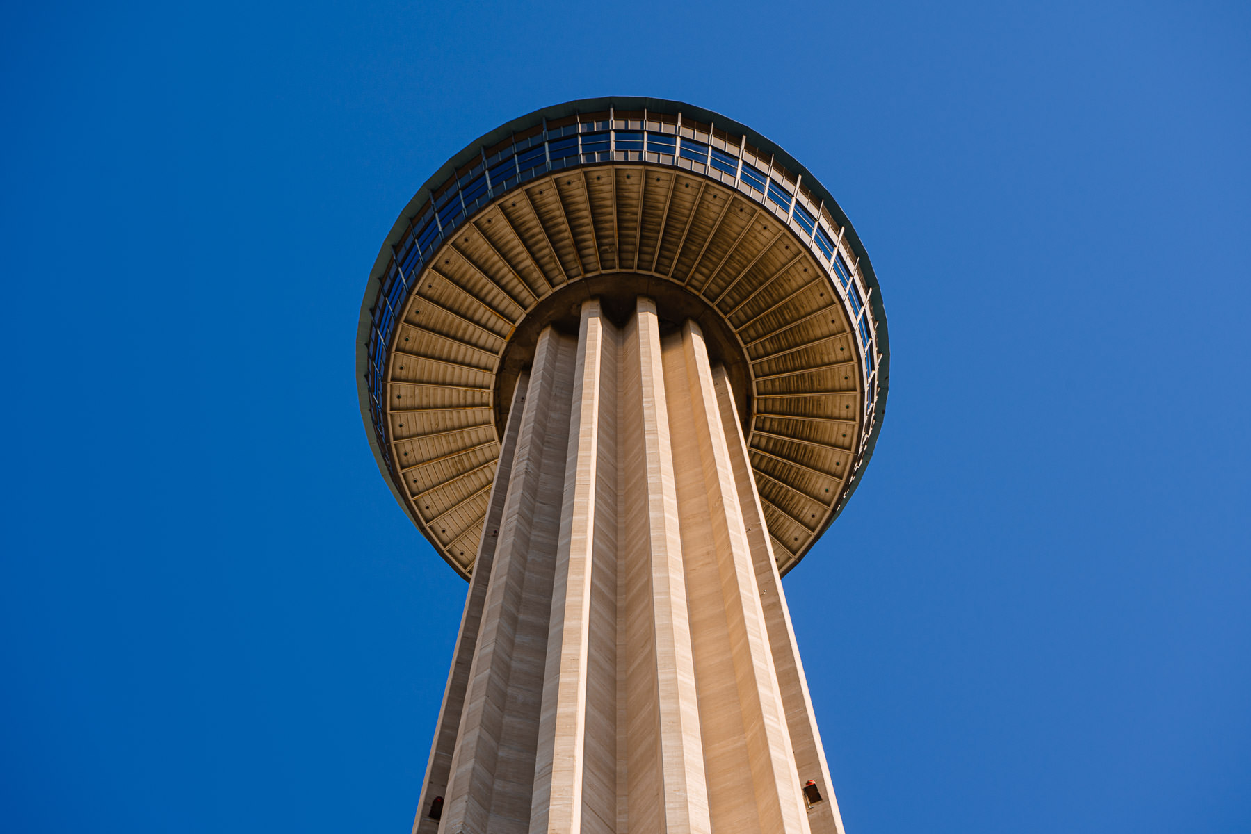 The 750-foot-tall Tower of the Americas rises into the clear blue sky over San Antonio, Texas.