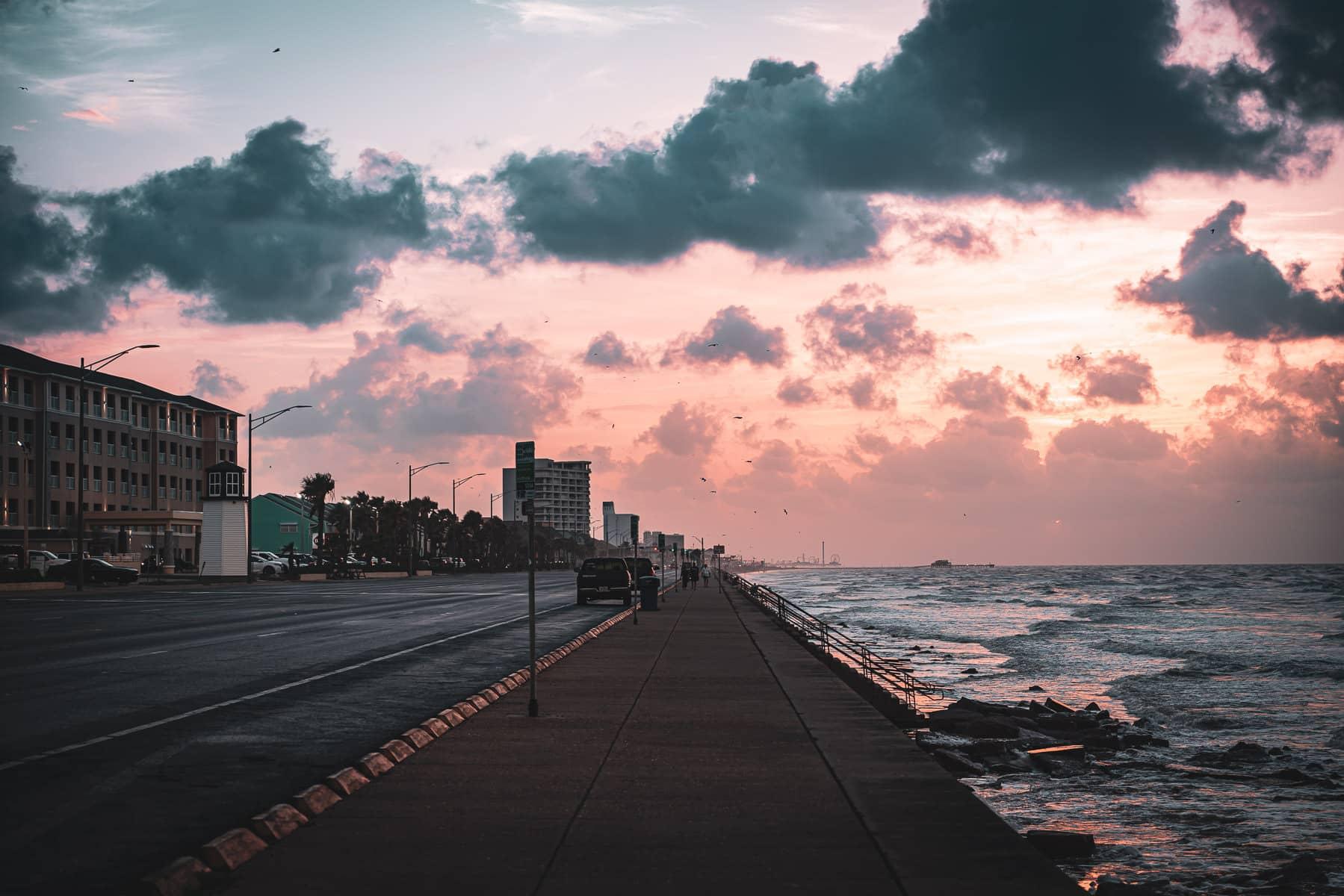 The sun rises on the Galveston, Texas, seawall.