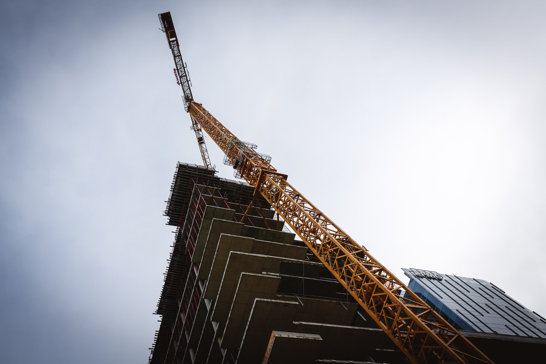A tower crane at a Downtown Dallas construction site.