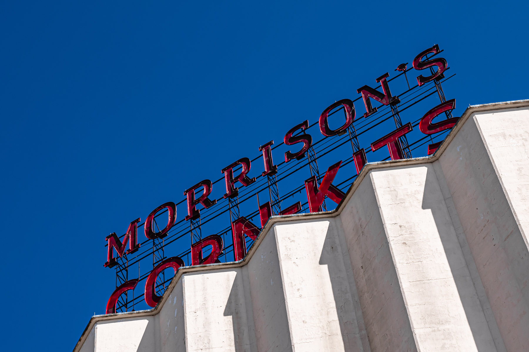 A sign for Morrison's Corn-Kits atop a Denton, Texas, grain elevator.