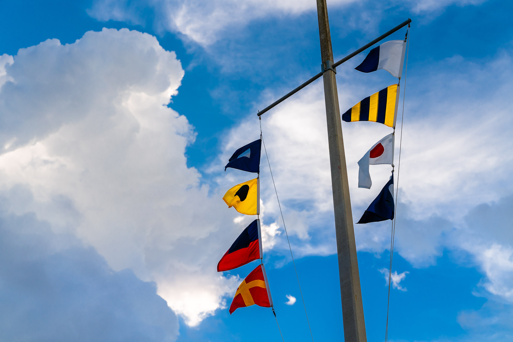 Maritime flags flutter in the breeze in Galveston, Texas.