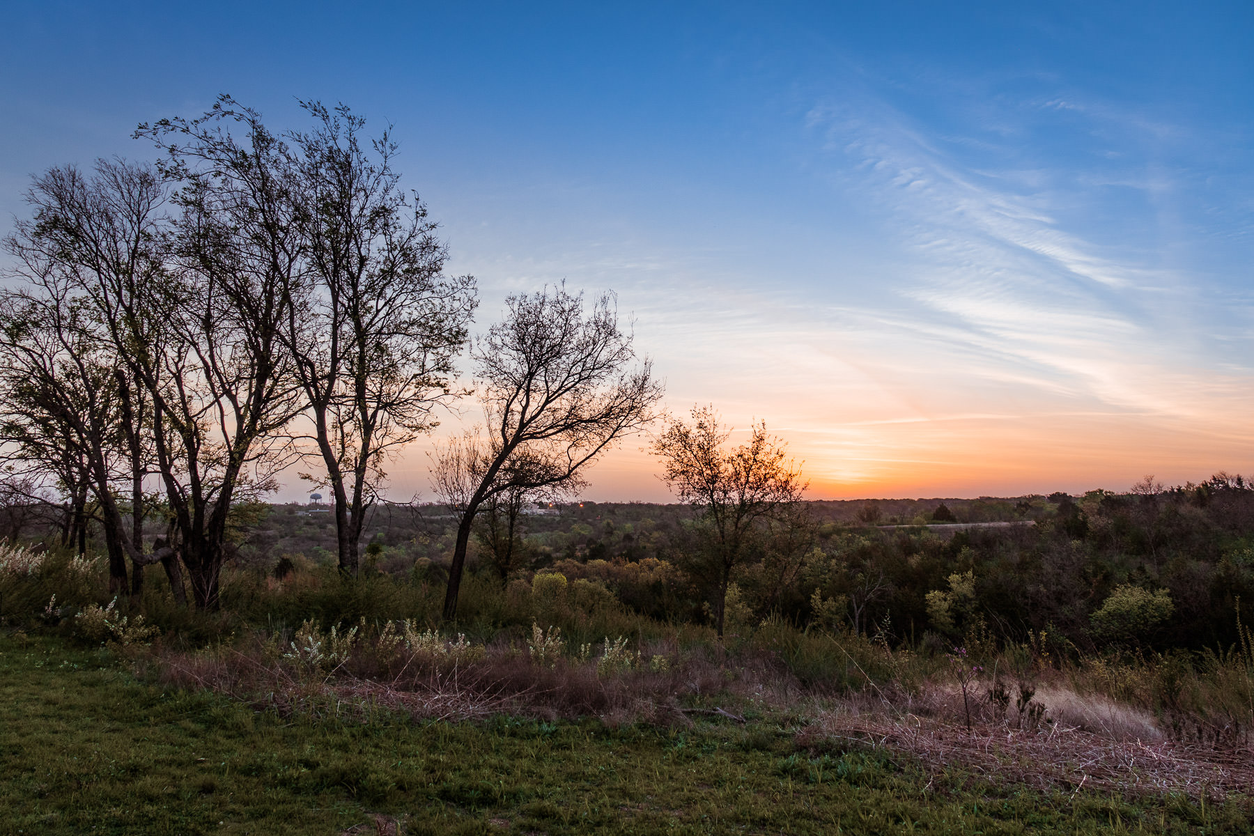 The sun rises on Fort Worth, Texas, as seen from the Tandy Hills Natural Area.