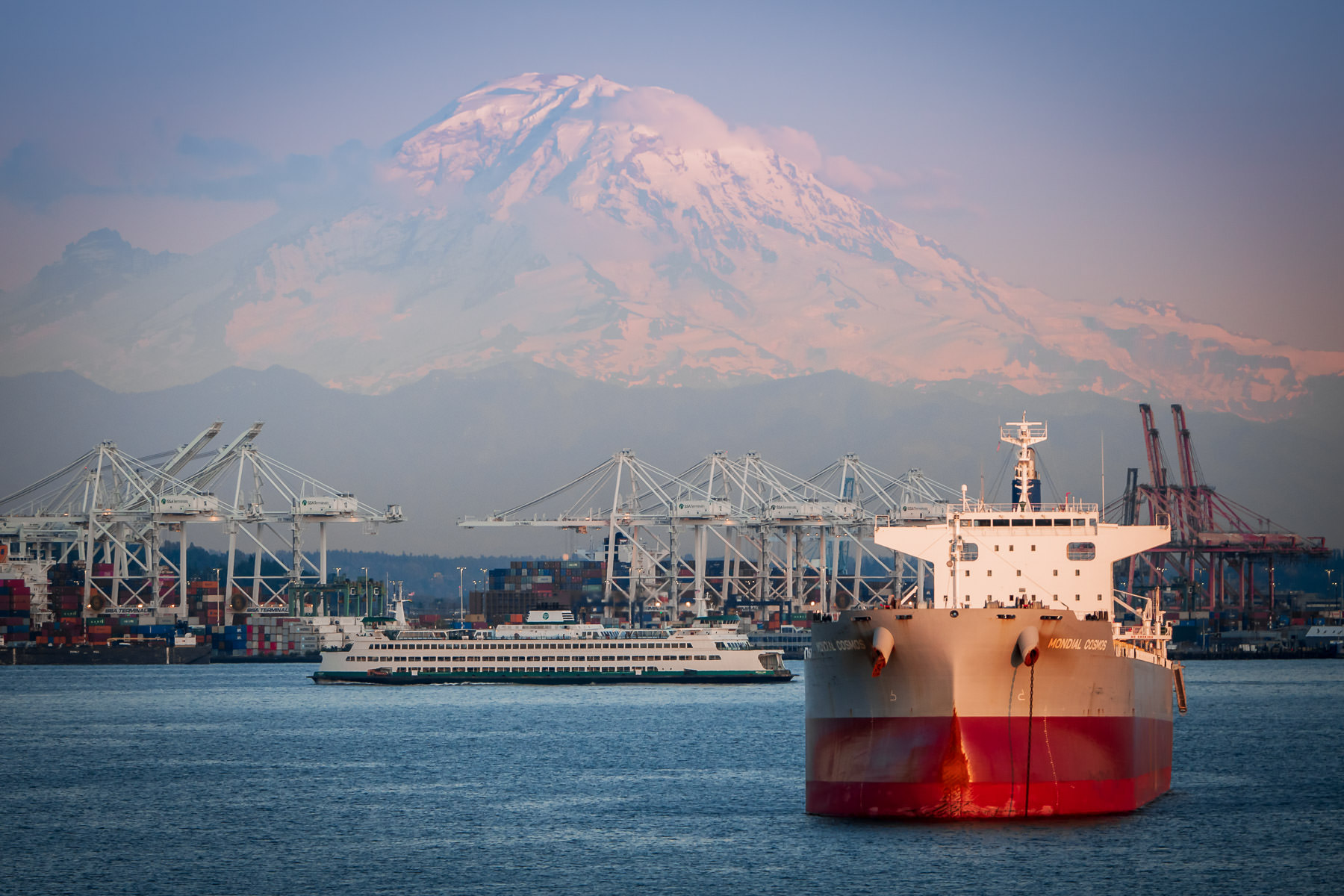Mount Rainier rises over the Port of Seattle.