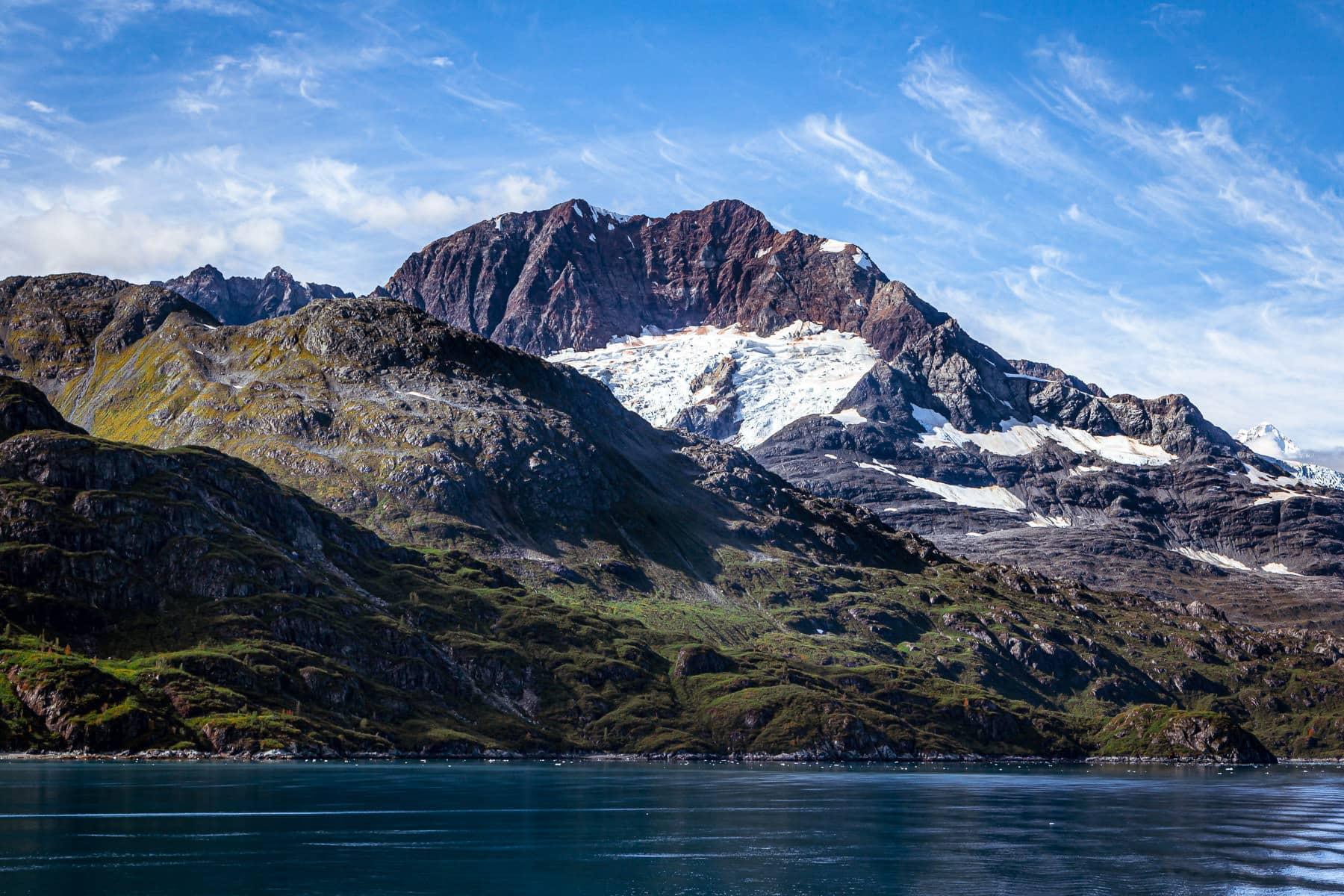 A glacier on the side of a mountainous ridge at Alaska's Glacier Bay National Park.