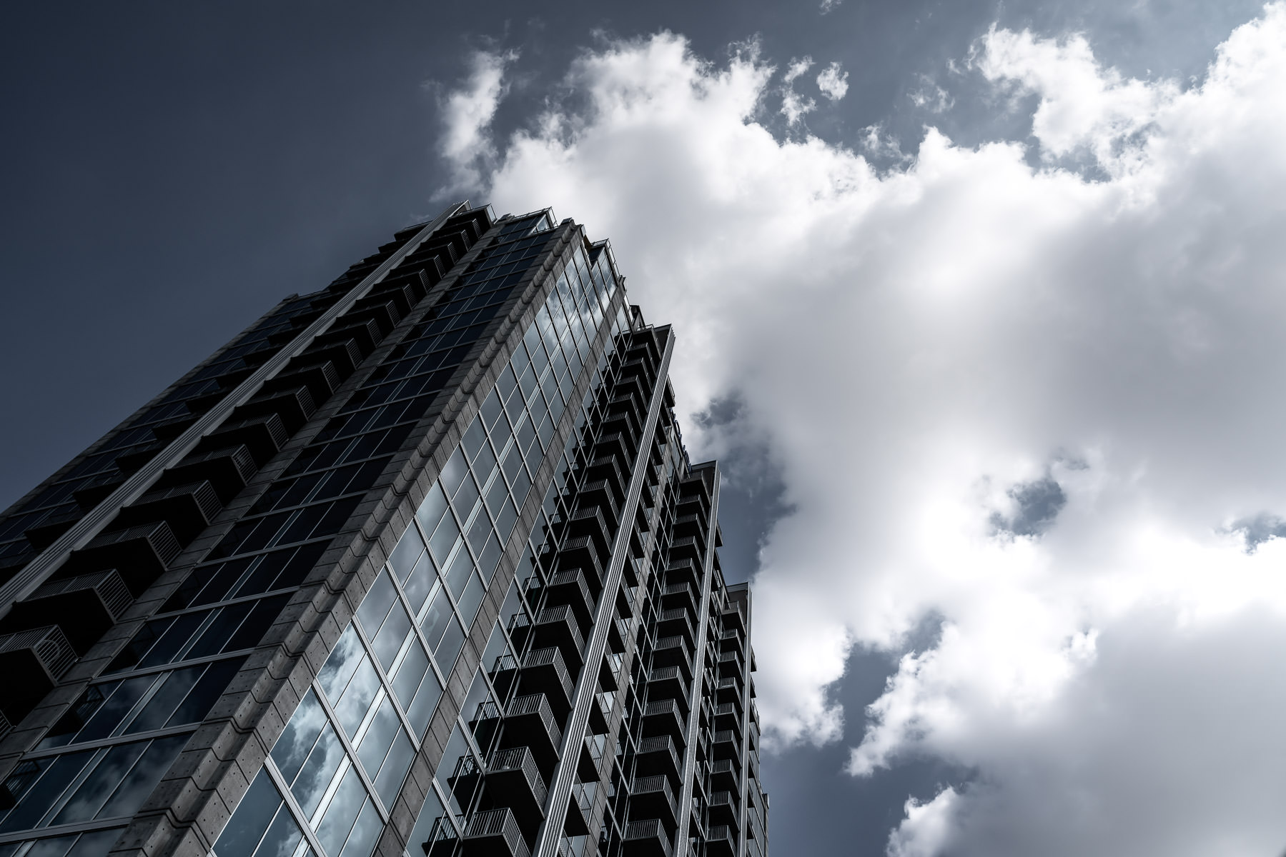 Skyhouse Dallas reaches to the clouds over North Texas.