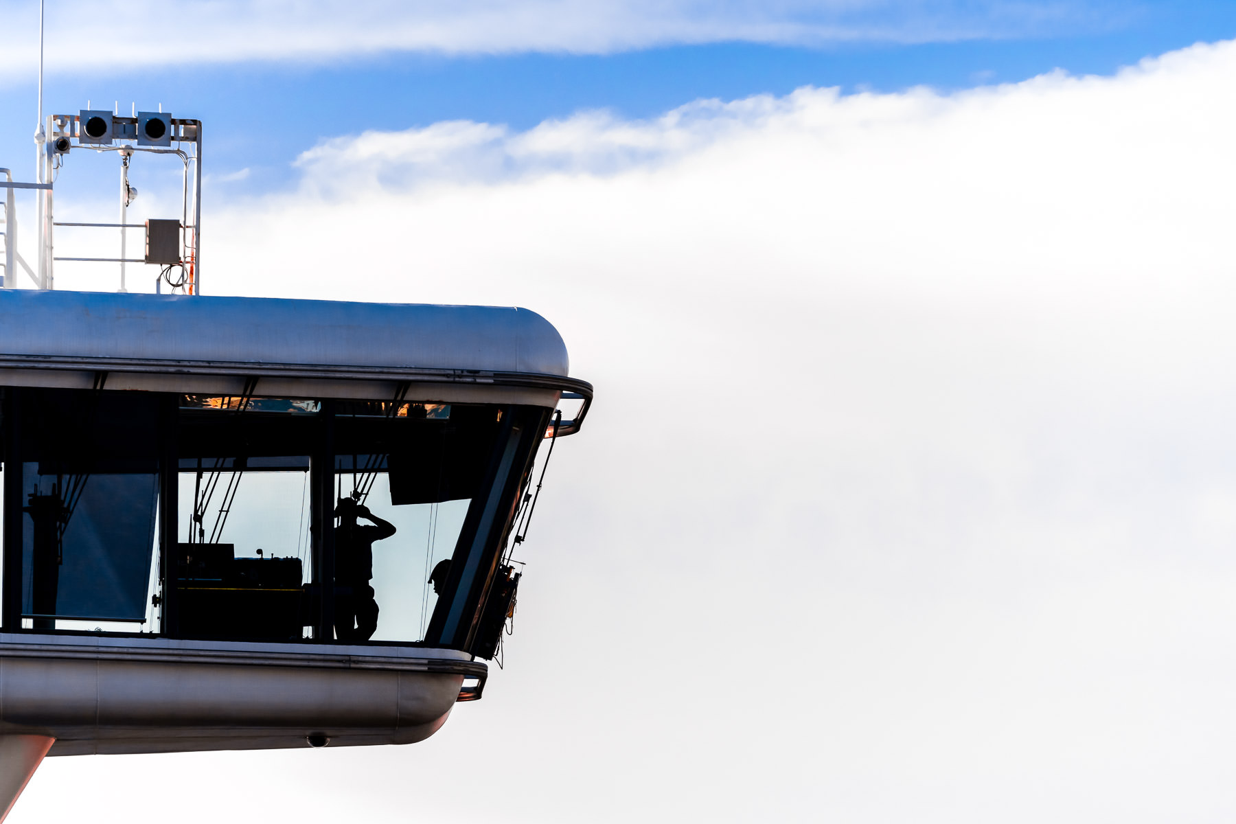 A member of the cruise shipStar Princess' bridge crew is silhouetted by the sky as she departs Seattle, Washington.
