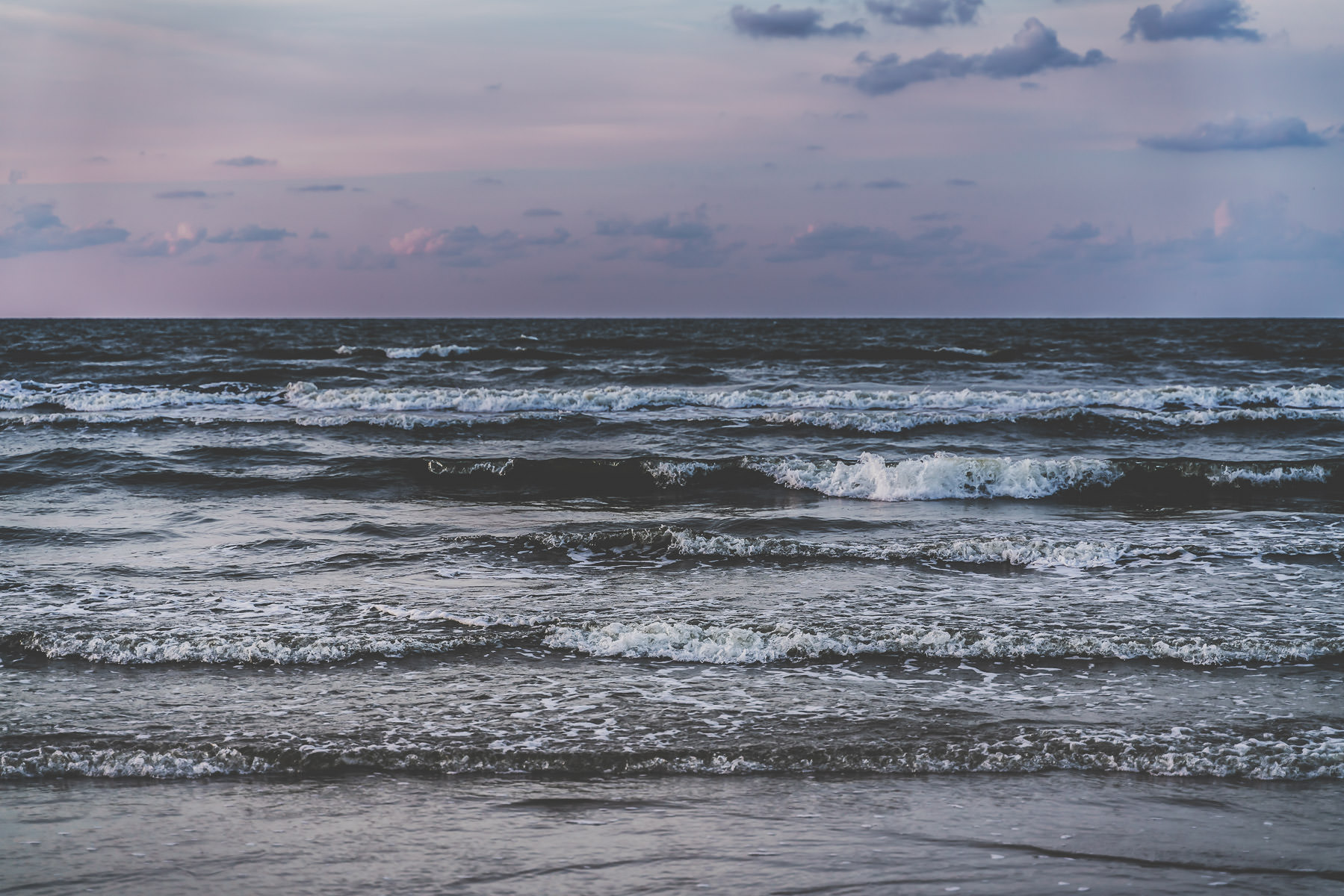 Waves roll ashore on a Galveston, Texas, beach.