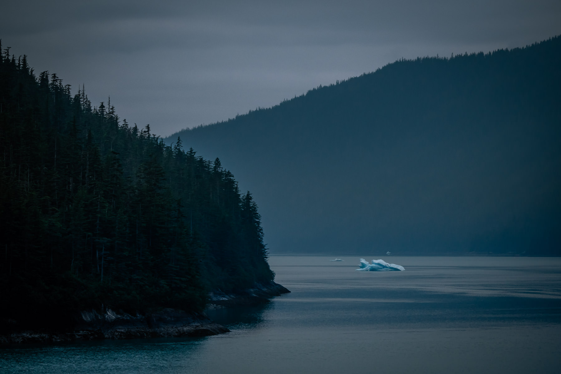 An iceberg floats in Alaska's Stephens Passage near Juneau in the morning twilight.