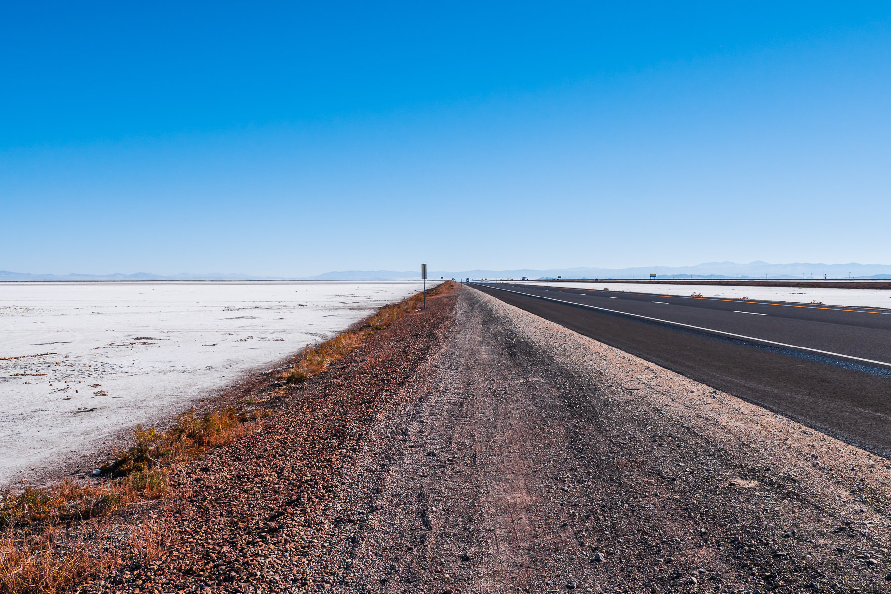 Interstate 80 reaches across the desert landscape of Utah's Bonneville Salt Flats.