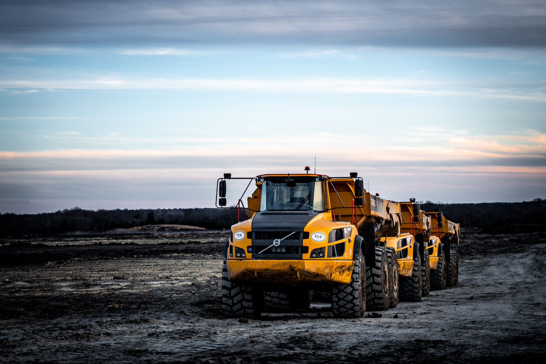 Dump trucks at a construction site near McKinney, Texas.
