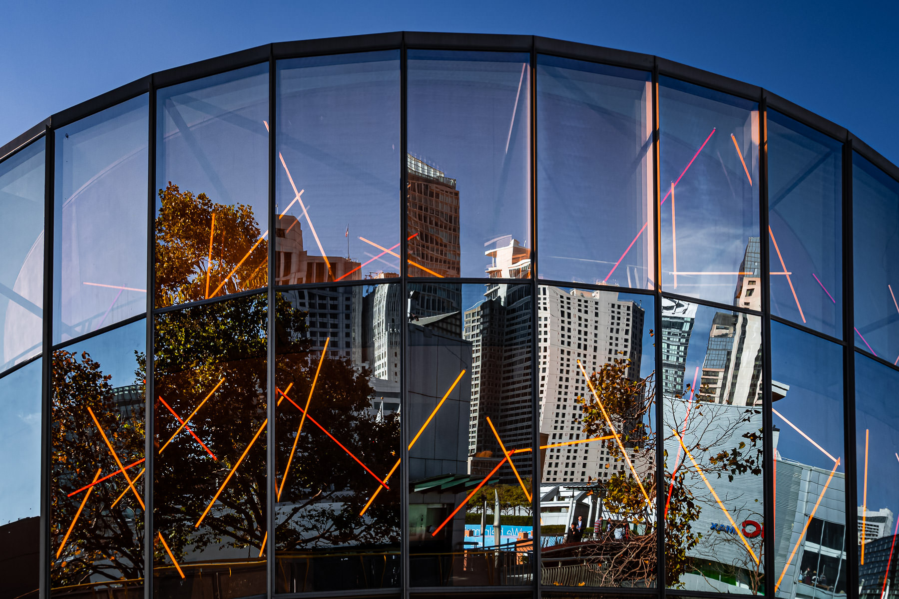 Skyscrapers are reflected in the glass façade of San Francisco's Children's Creativity Museum.