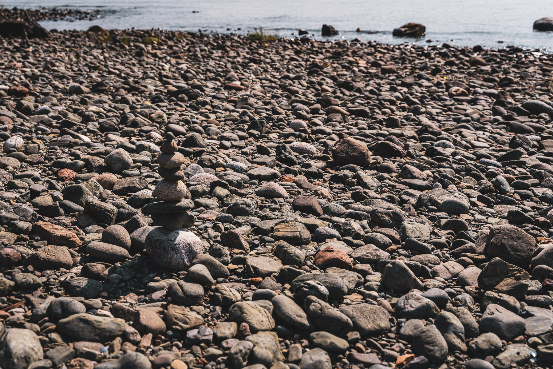Stones stacked on a rocky shore in Juneau, Alaska.