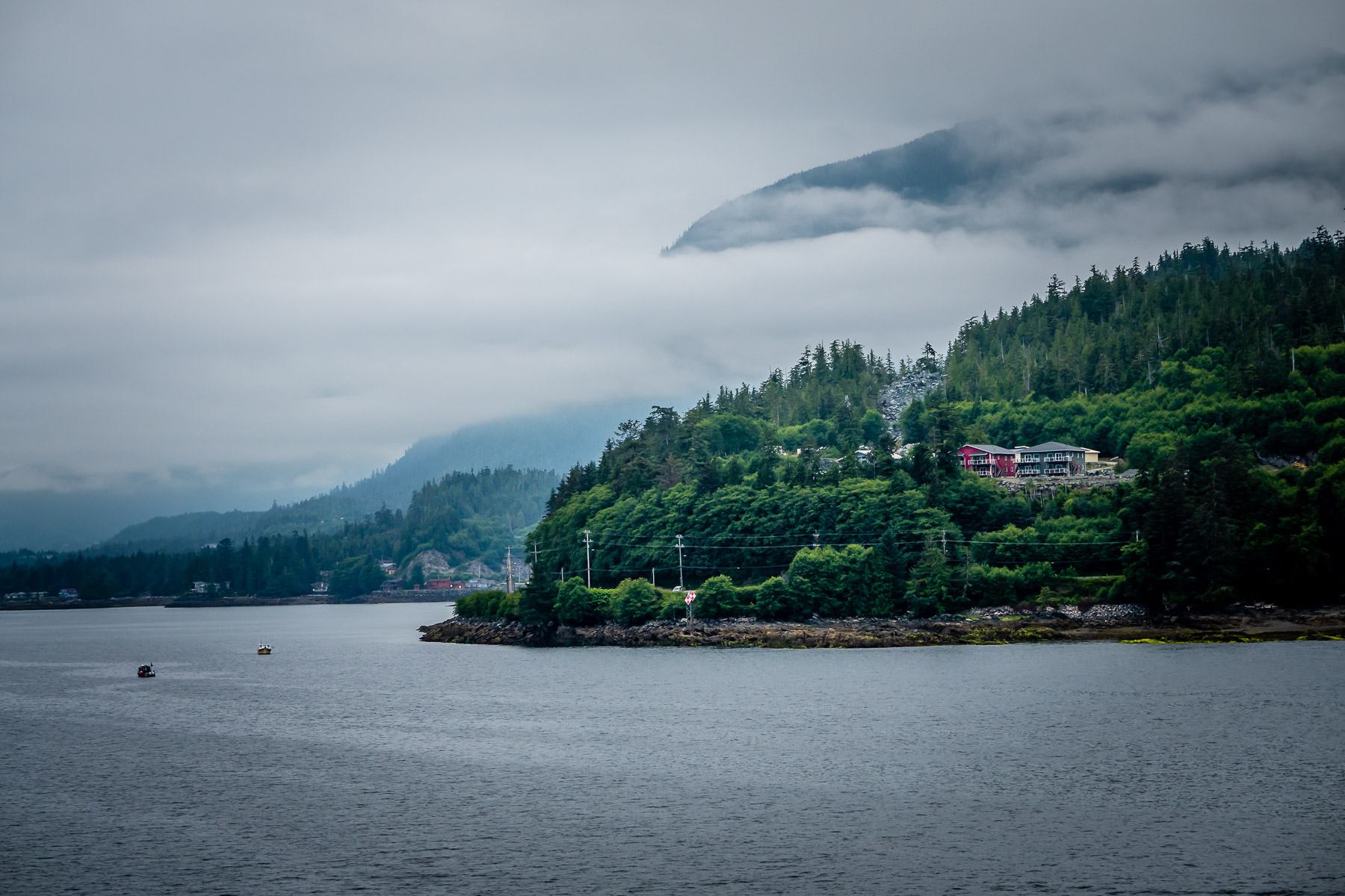 The morning fog of the Tongass Narrows begins to lift on Ketchikan, Alaska.