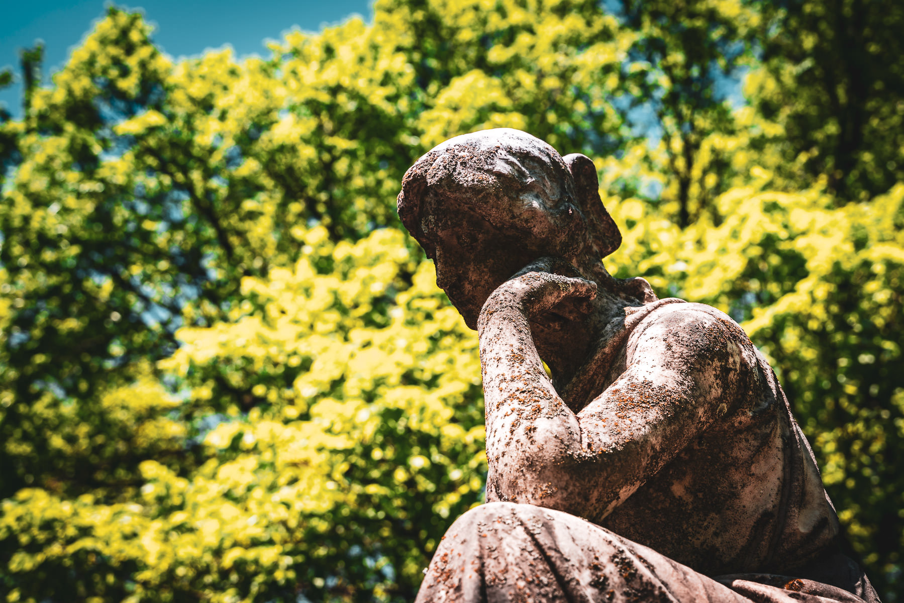 A thoughtful statue at McKinney, Texas' Pecan Grove Cemetery.