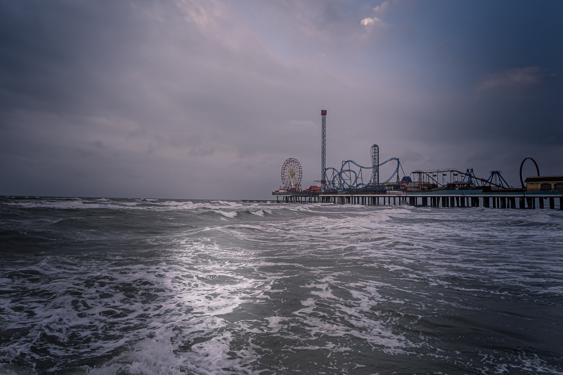 Galveston, Texas' Historic Pleasure Pier on dreary, overcast day.