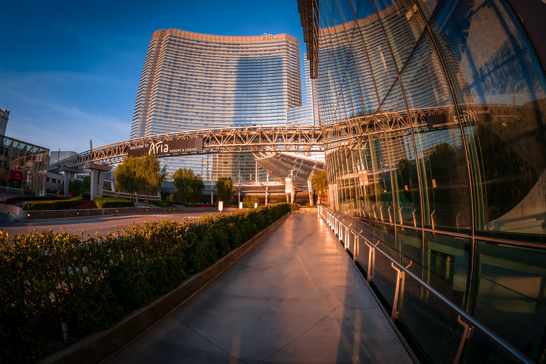 A sidewalk leads past the Veer Towers towards ARIA Resort & Casino at CityCenter, Las Vegas.