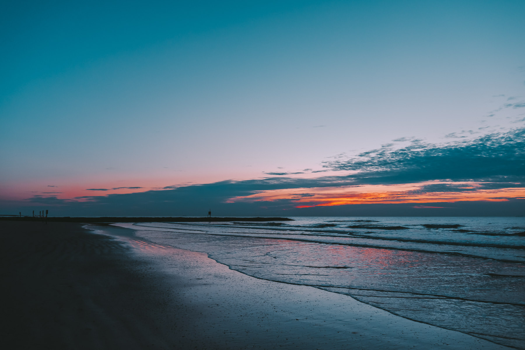 The first light of day on a Galveston,Texas, beach.