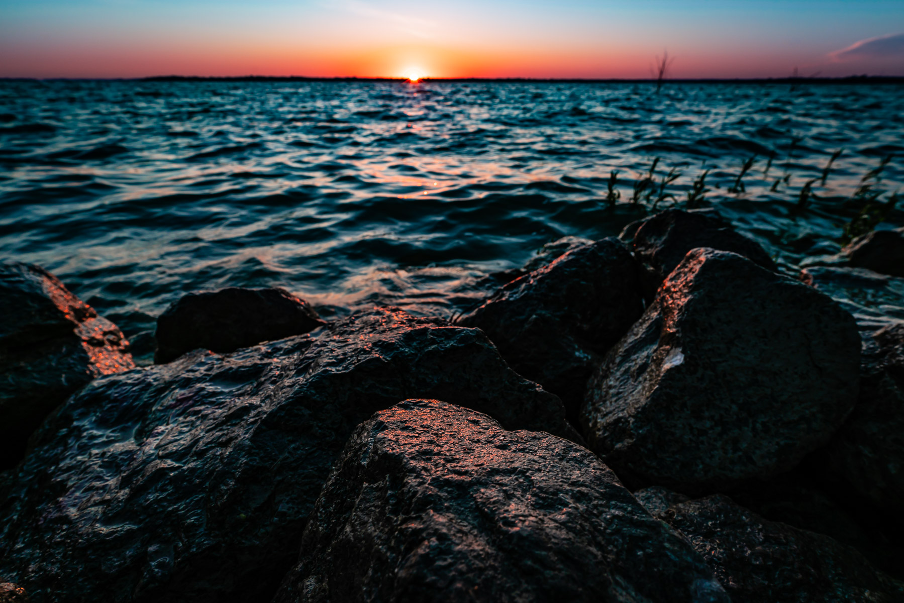 Sunrise along the rocky shore of North Texas' Lake Lavon.