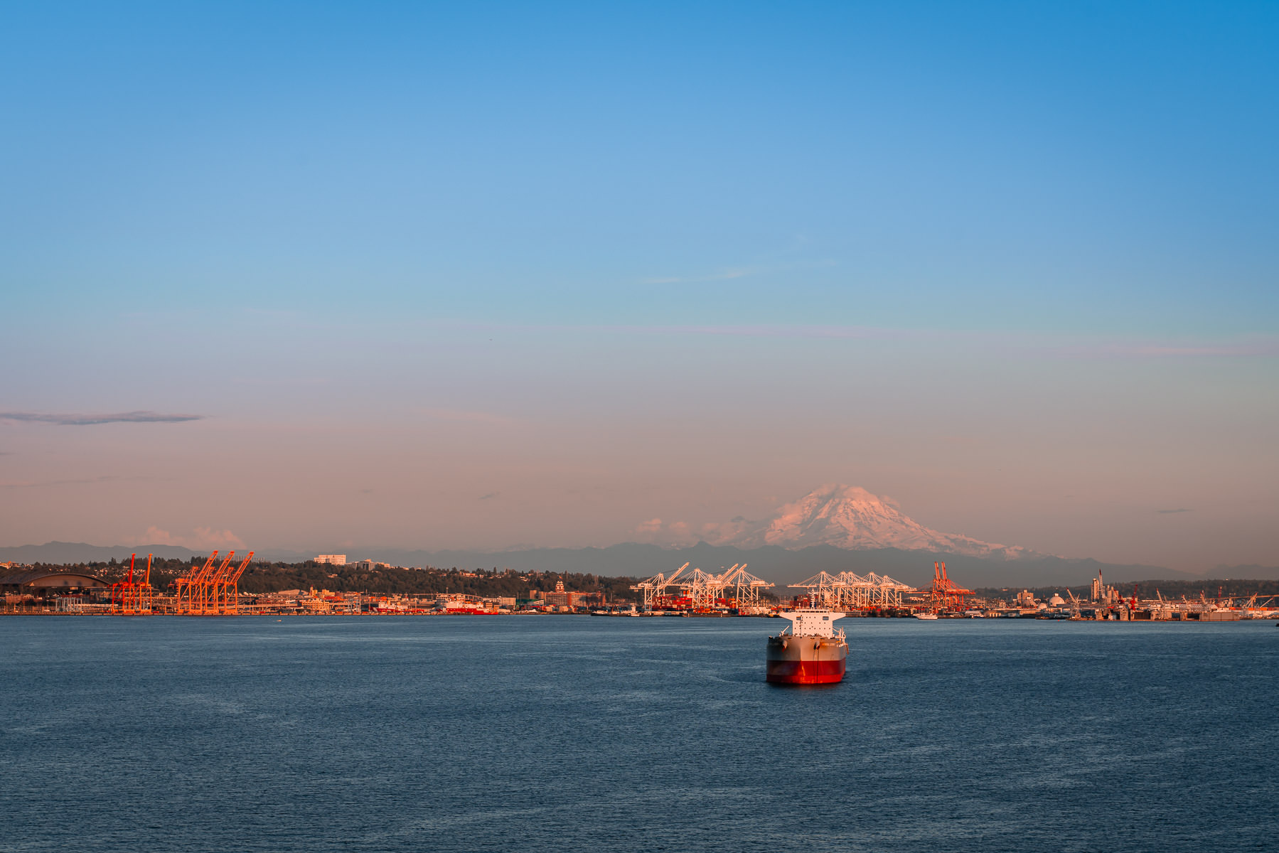 Mount Rainier rises over the Port of Seattle.