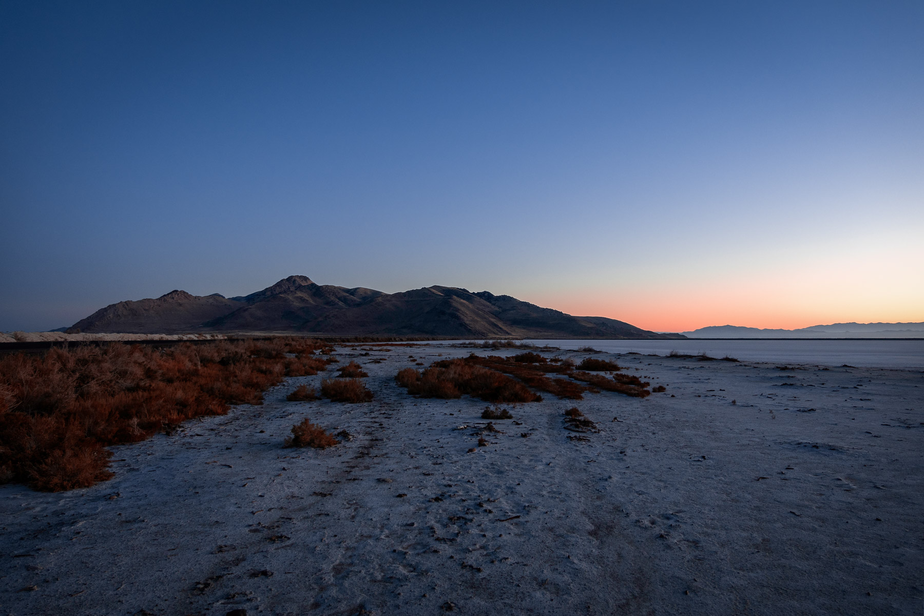 The sun rises on Utah's Stansbury Island along the edge of the Great Salt Lake near Tooele.