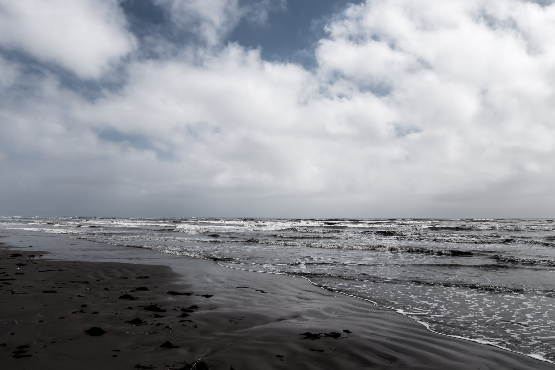 A lonely Galveston Island, Texas, beach on a cold, cloudy day.