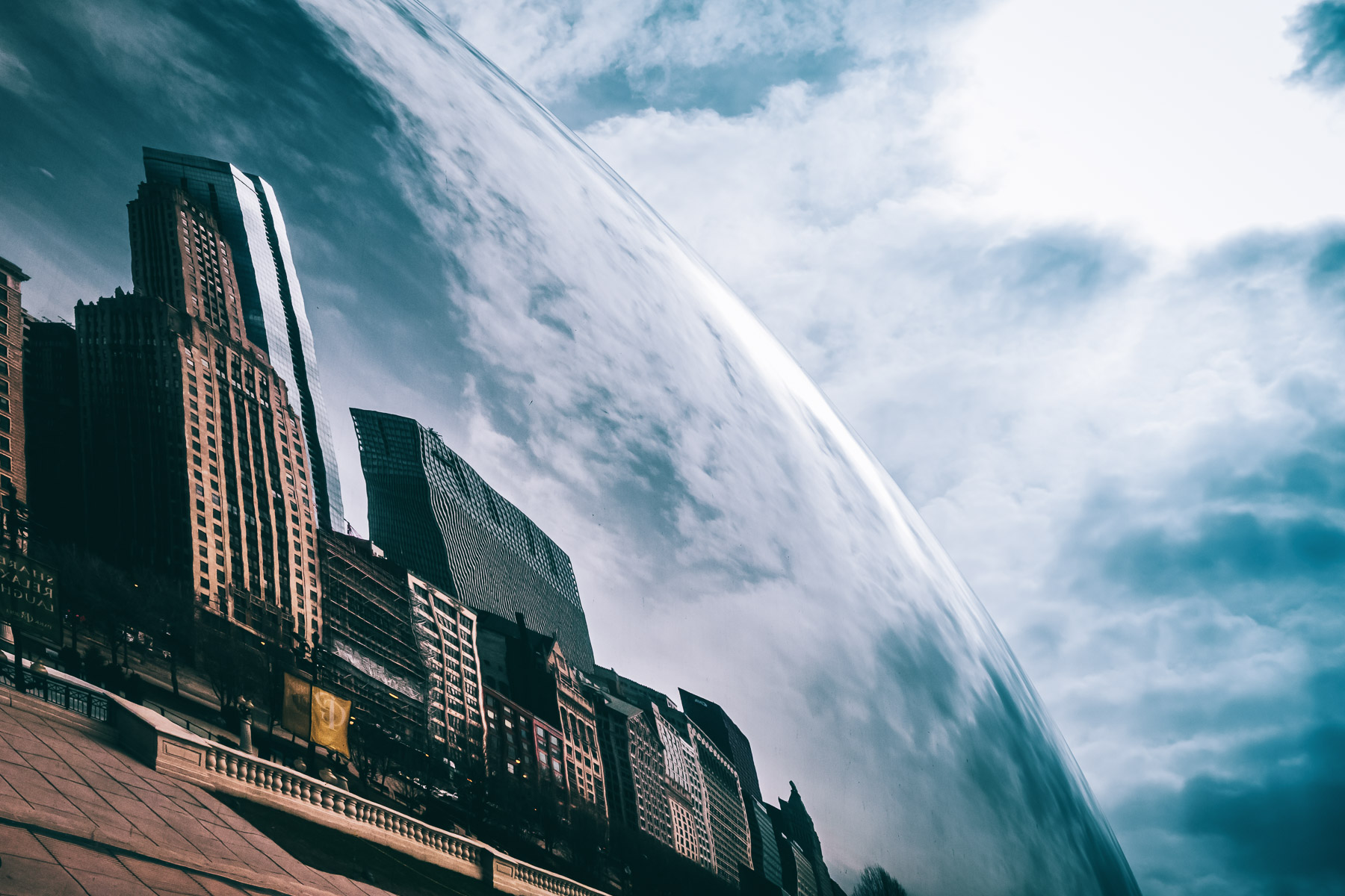 "Anish Kapoor's Cloud Gate, colloquially known as ""The Bean"", bends and reflects nearby buildings at Millennium Park, Chicago."