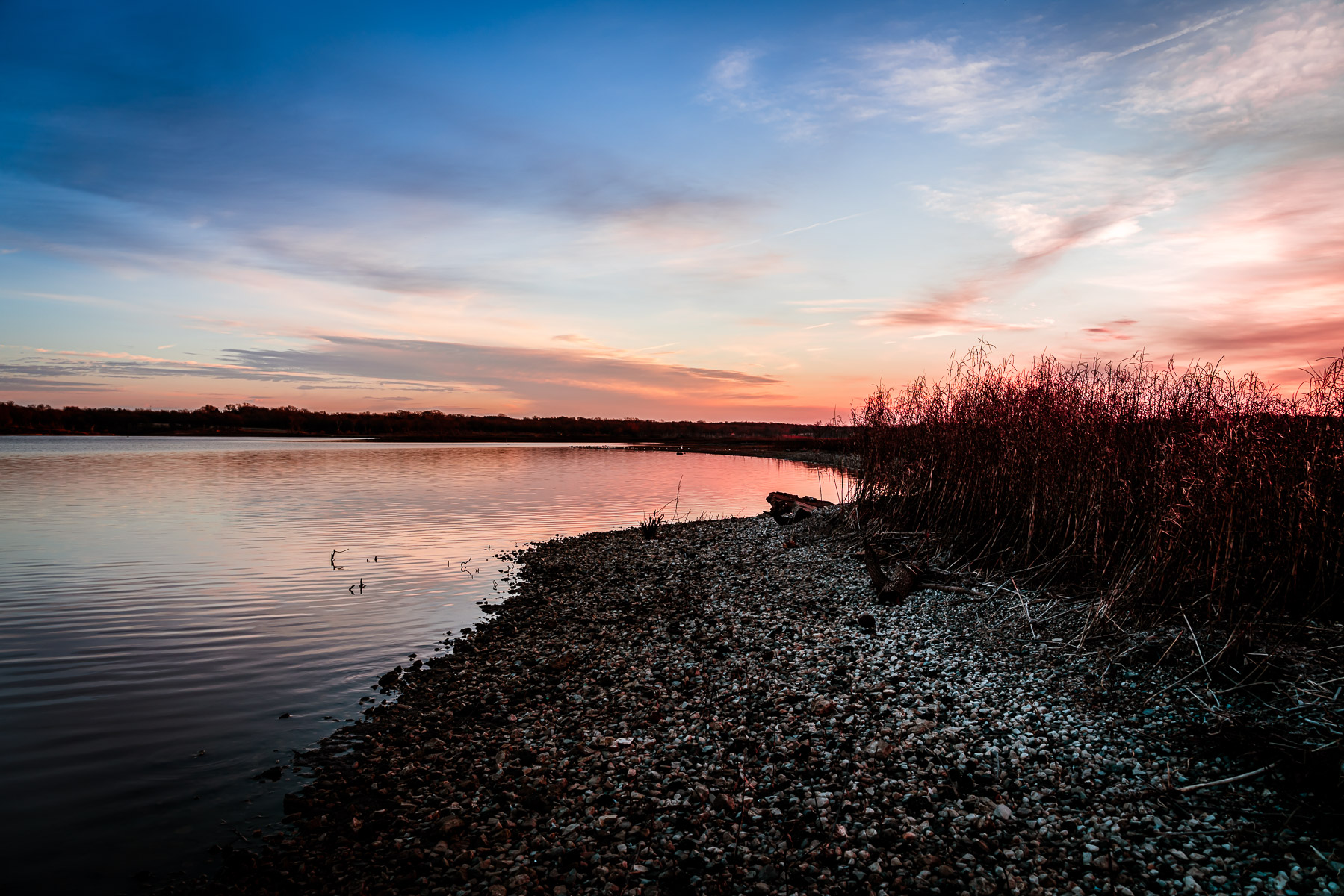 The sun begins to rise on the Big Mineral Arm of Lake Texoma at the Hagerman National Wildlife Refuge, Texas.