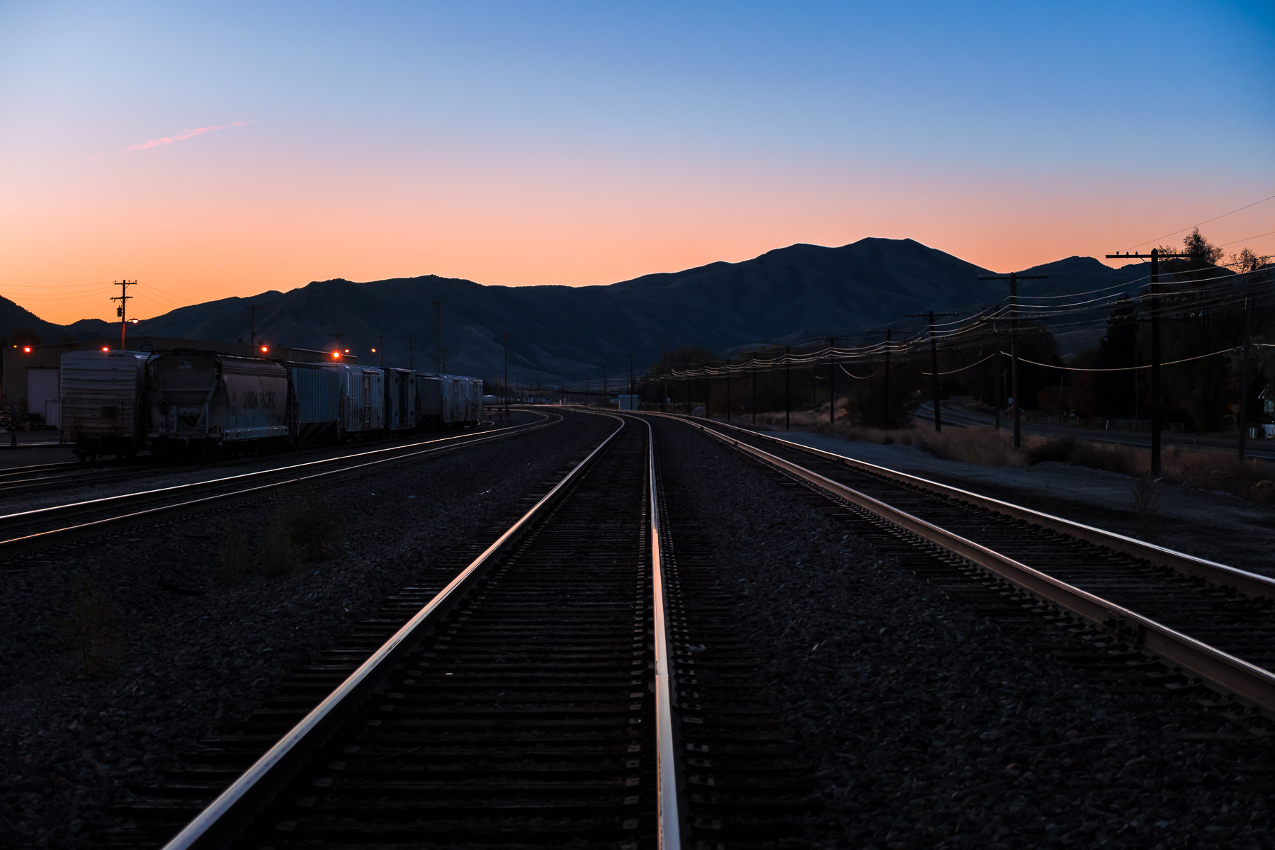The sun begins to rise on a railyard in Pocatello, Idaho.