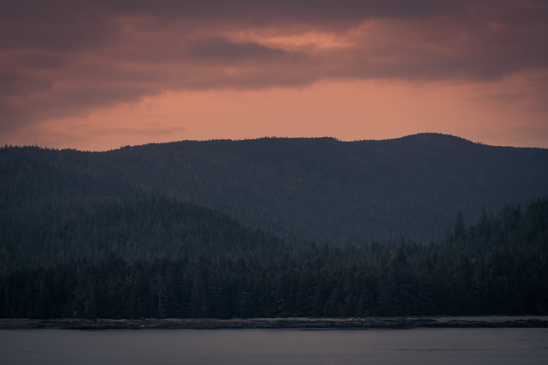 The sun sets on the far side of Gravina Island near Ketchikan, Alaska.
