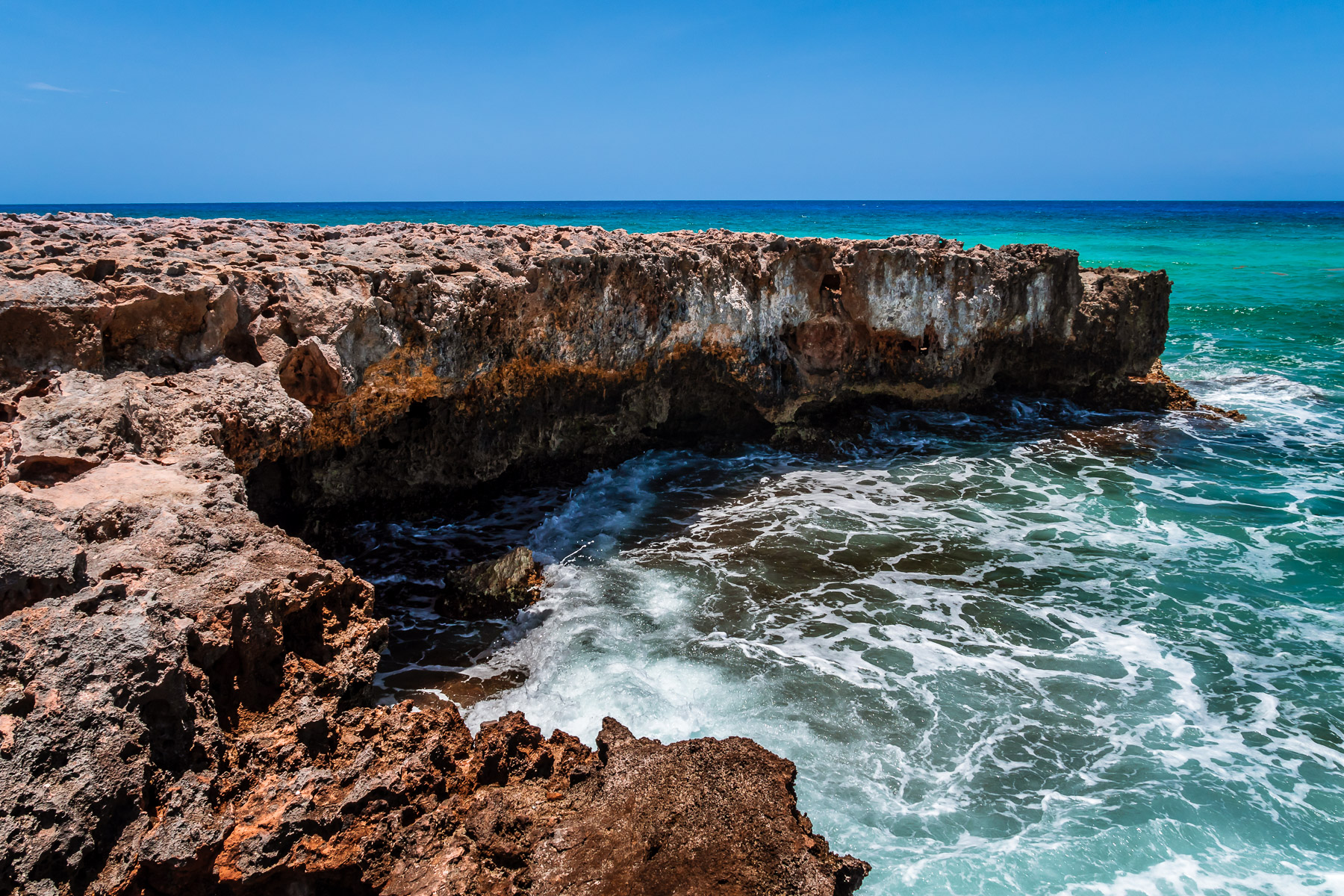 Rocks reach into the sea at El Mirador, Cozumel, Mexico.