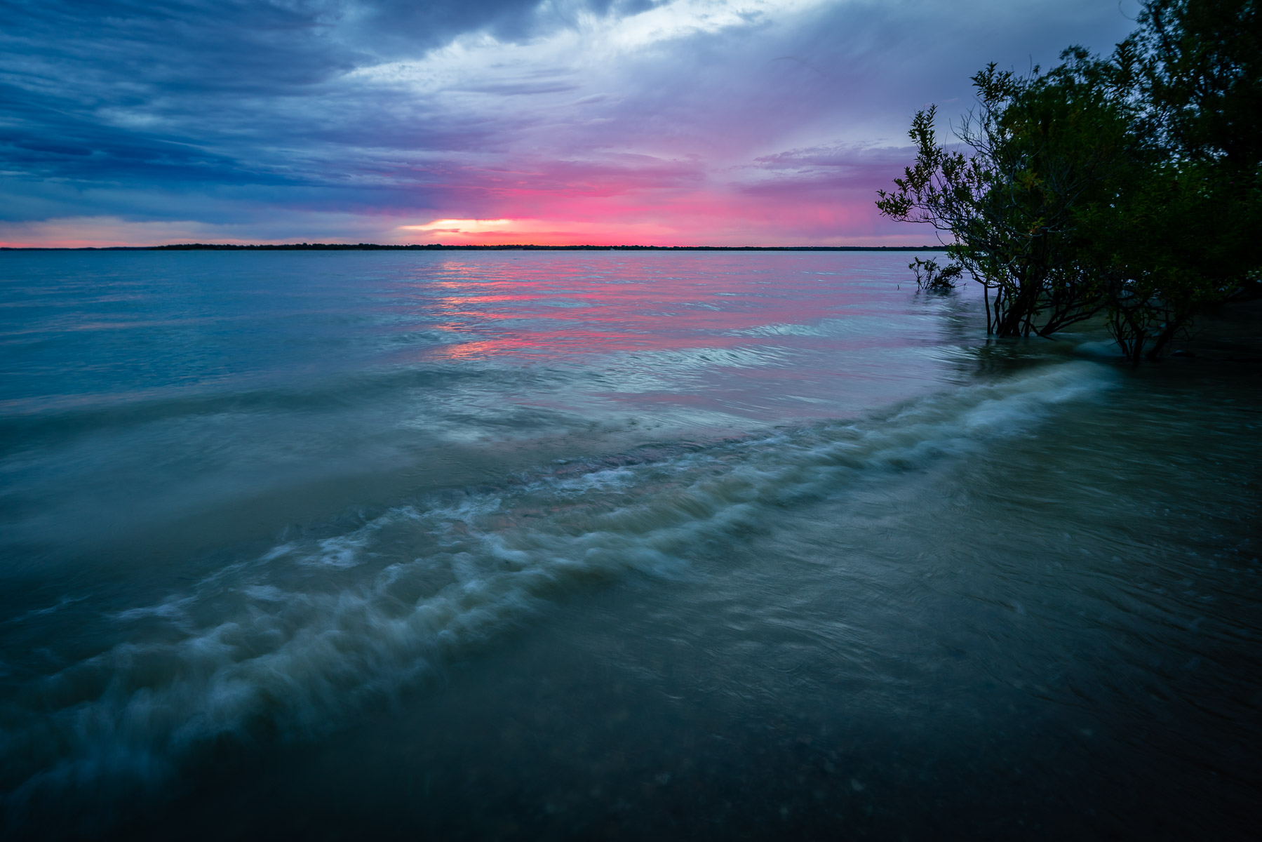 Waves roll onto the shore of North Texas' Lake Lavon.