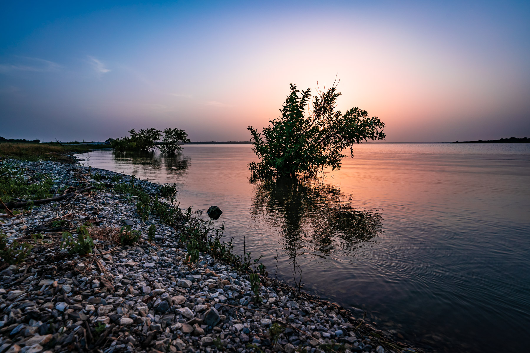 The sun sets on the Big Mineral Arm of Lake Texoma at the Hagerman National Wildlife Refuge, Texas.